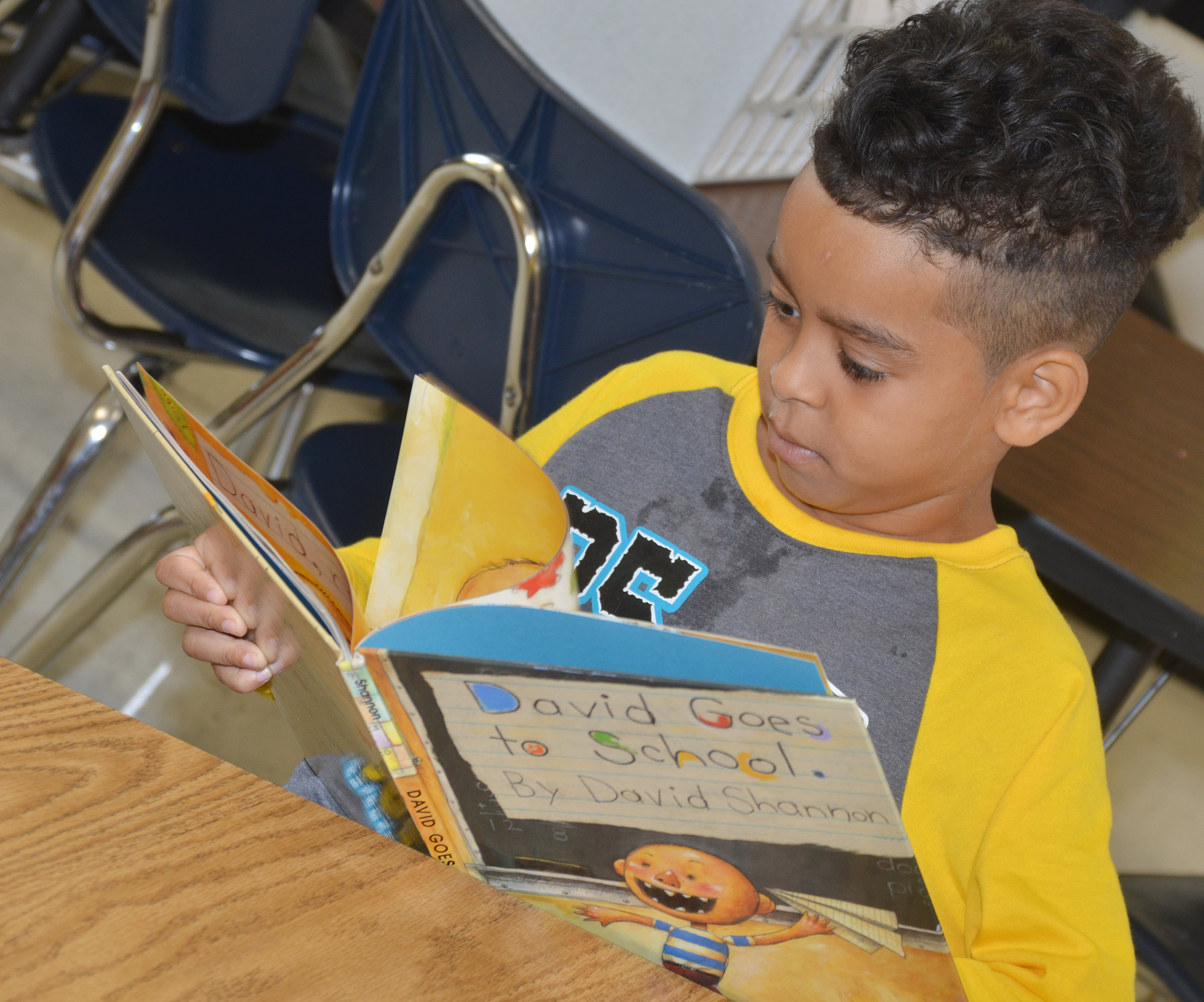 CES second-grader Jacob Hernandez shows his classmates the proper way to read a book.
