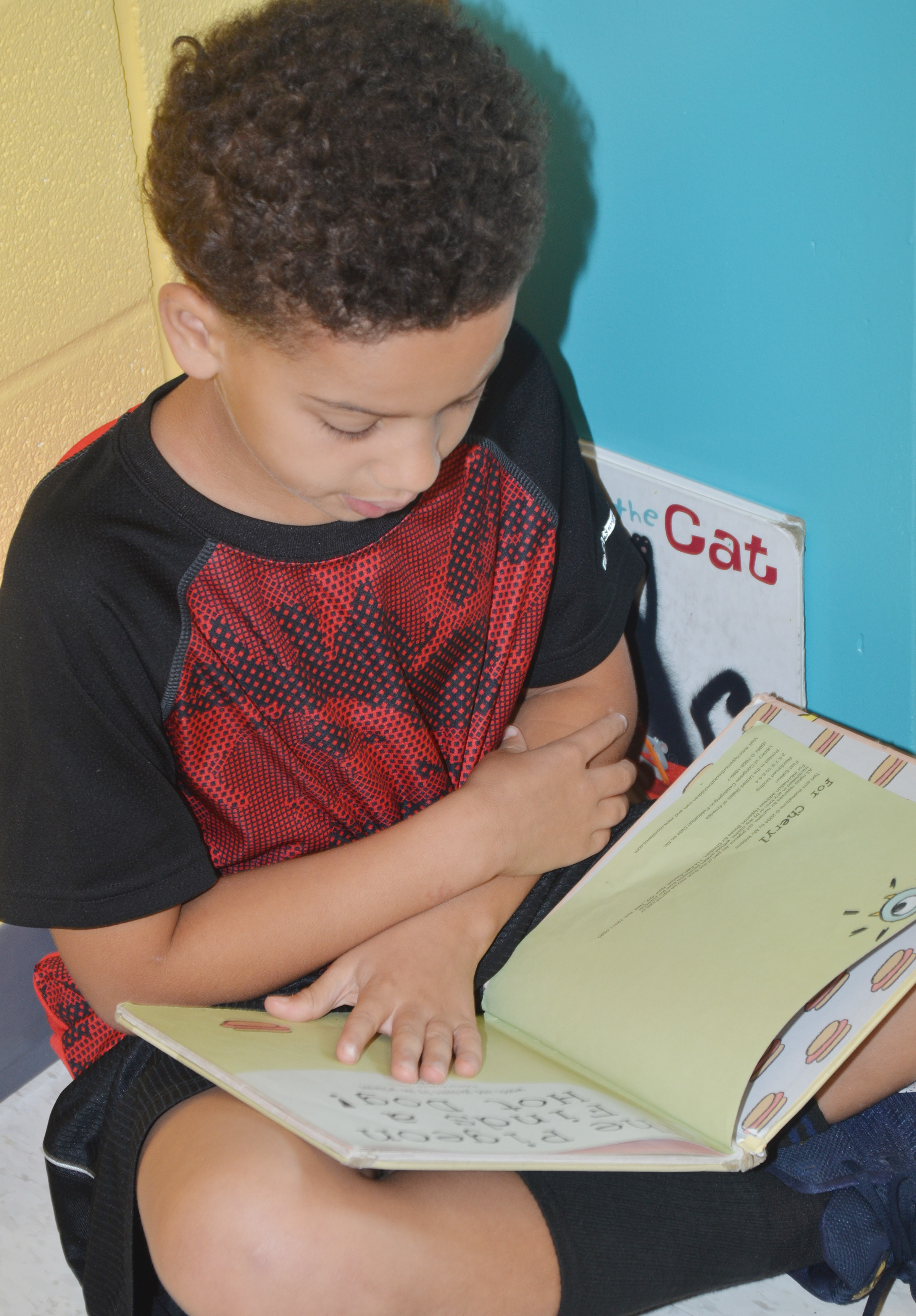 CES second-grader Bryant Mayo reads.