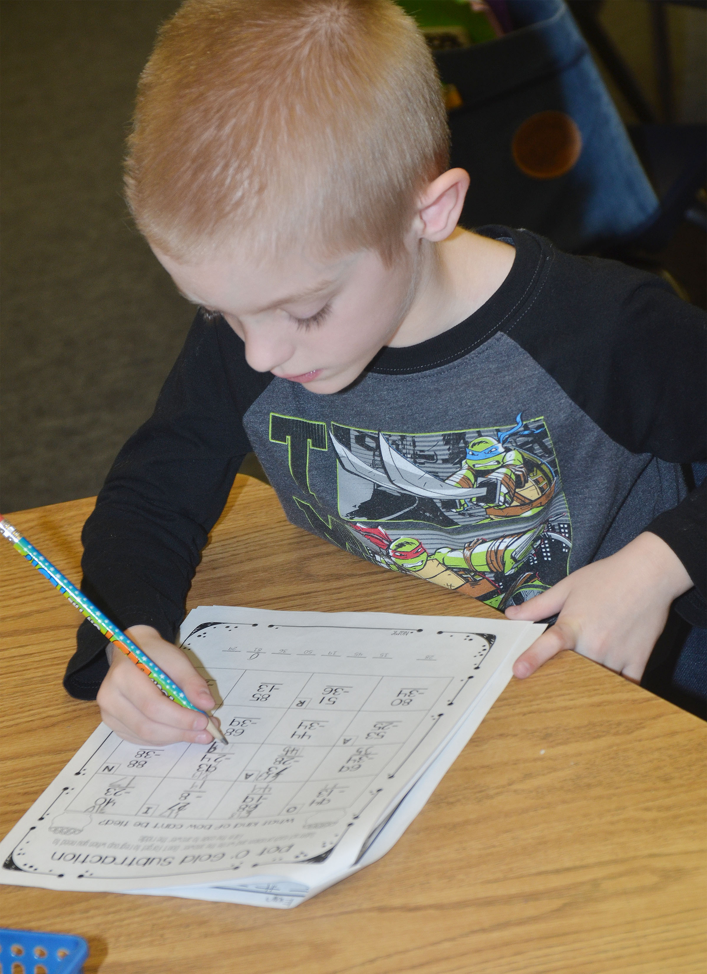 CES second-grader Evan Cundiff works a St. Patrick's Day math problem.