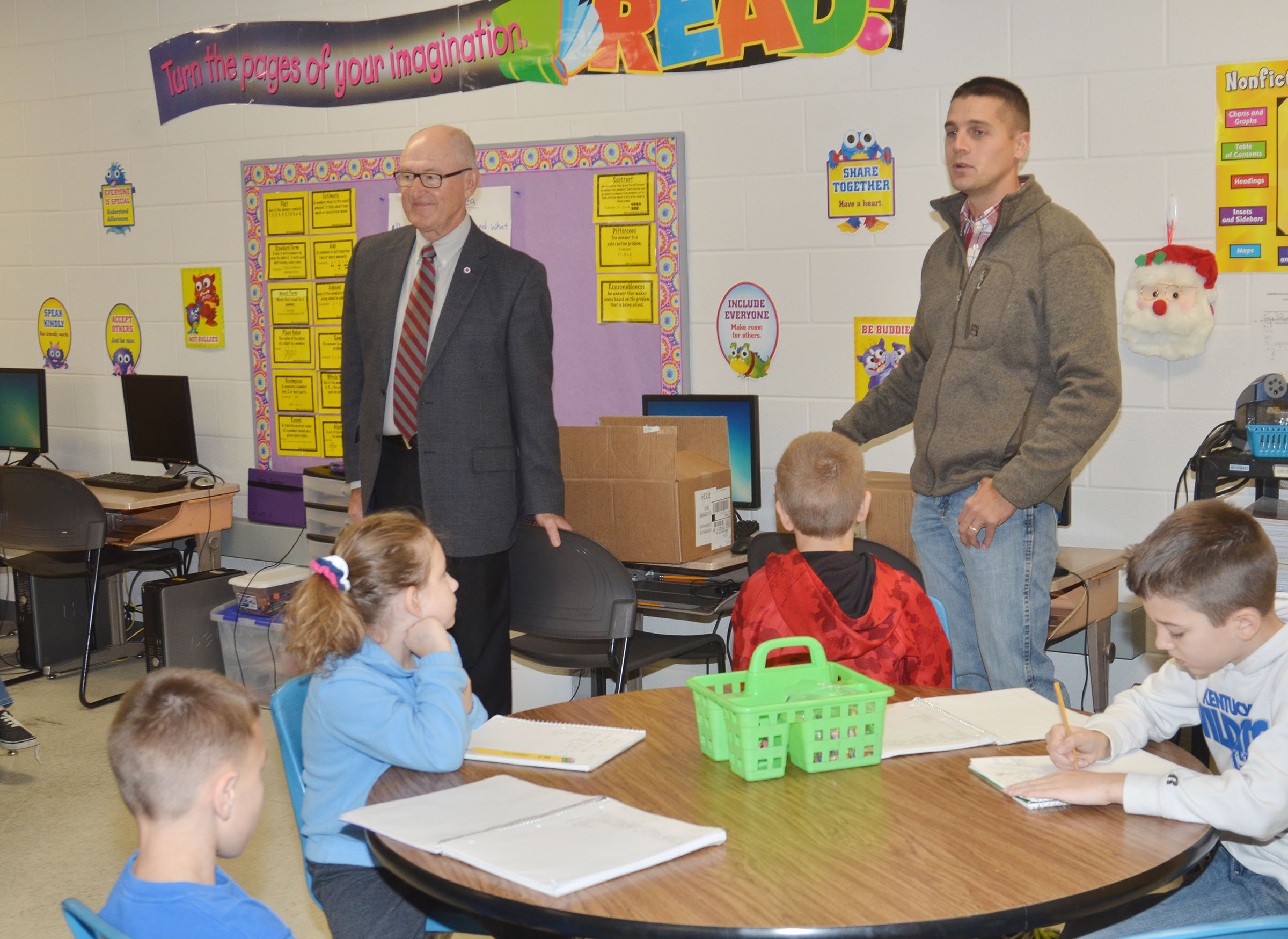 Campbellsville Rotary Club members Chuck Vaughn, at left, and Clark Howard talk to CES third-graders about the club and its service projects.