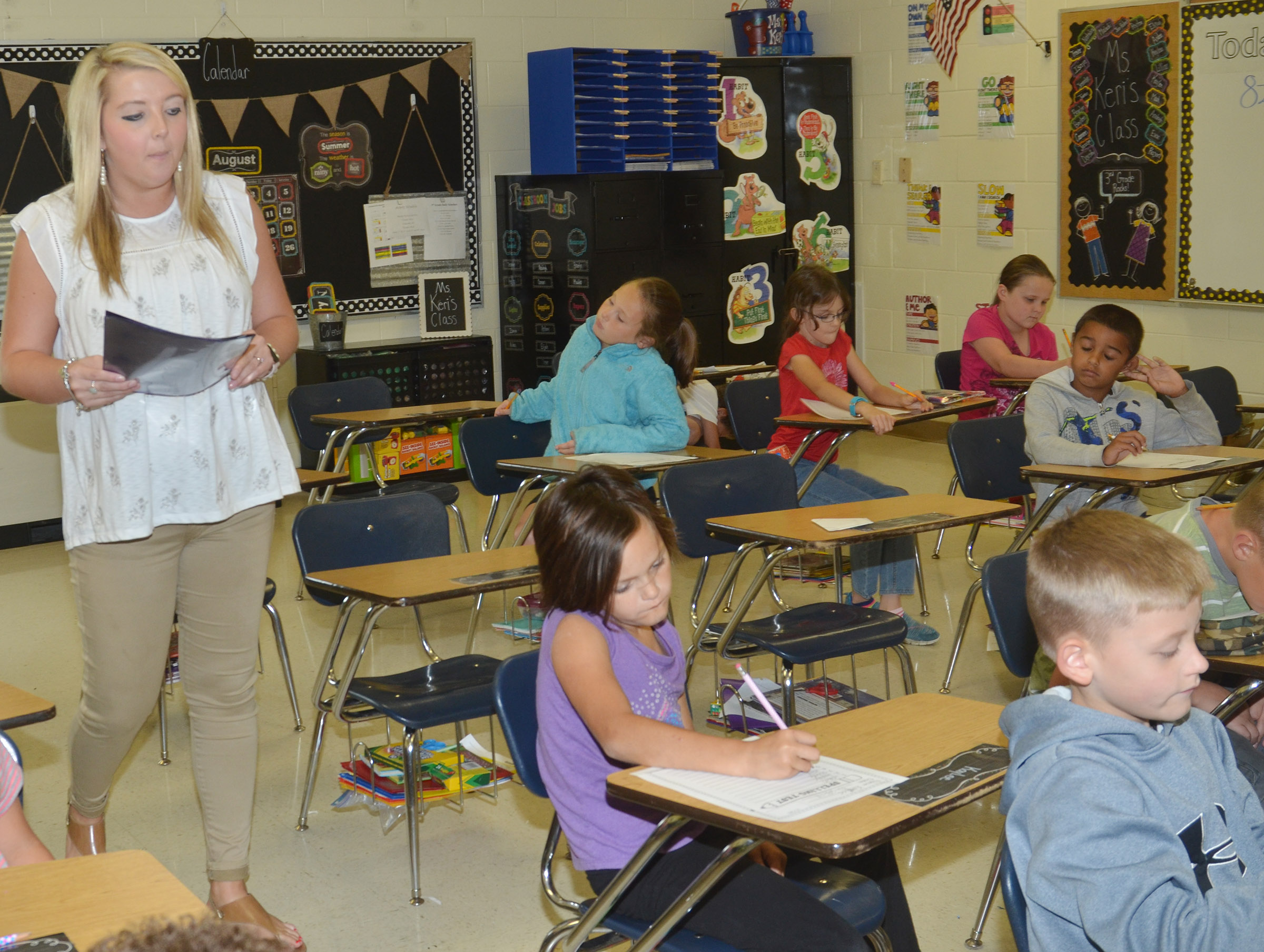 CES third-grader teacher Keri Rowe administers a spelling test for her students.