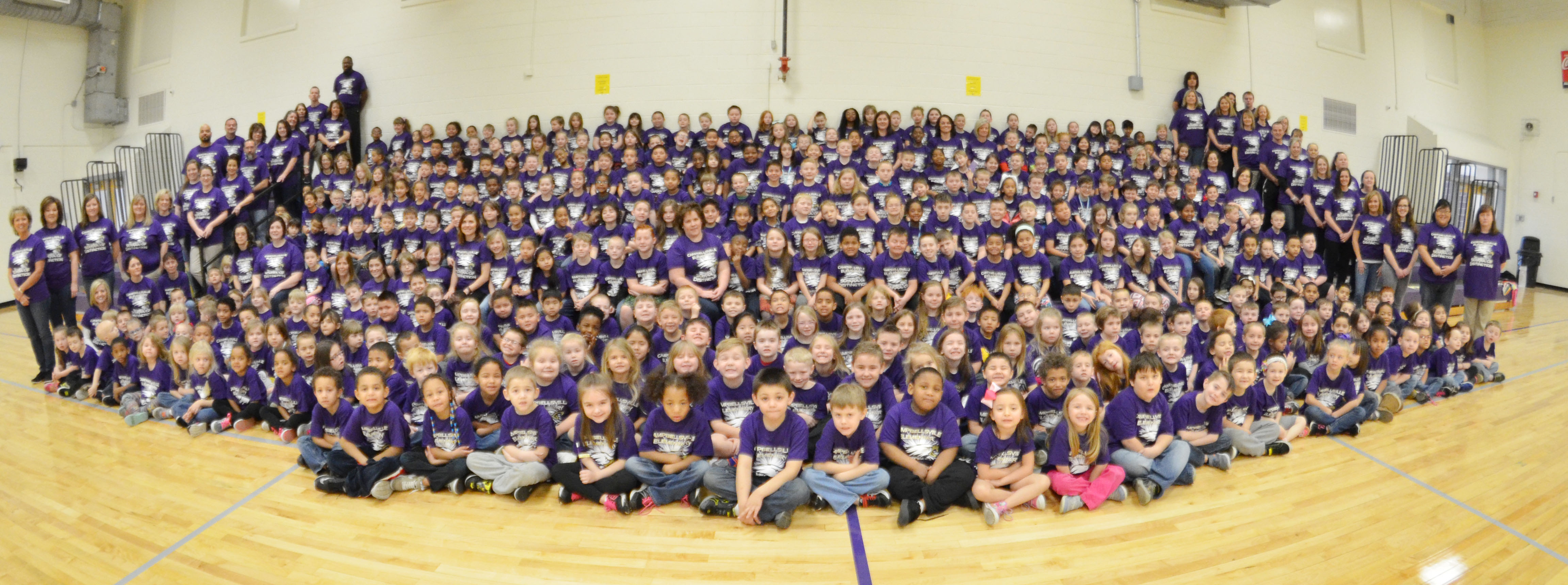 CES students, teachers, administrators and personnel wear their new School of Distinction t-shirts.