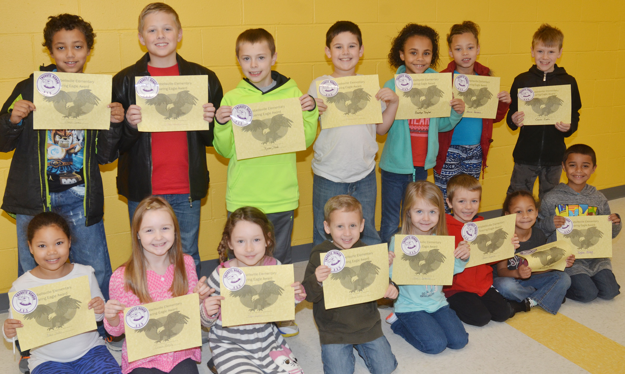 From left, front, are first-graders Briana Wooley, Gracie Murphy and Kaylee Gayheart, kindergarteners Gavin Paris, Jewell Brewster, Jason Eggers and Elyzabeth Fisher and second-grader Keylan Strong. Back, third-grader Chance Owens, second-grader Evan Lockridge, third-grader Keaton Hord, second-graders Damien Clark and Braelyn Taylor and third-graders Alexis Graves and Connor Coots. Absent from the photo is first-grader Aaron Floyd.