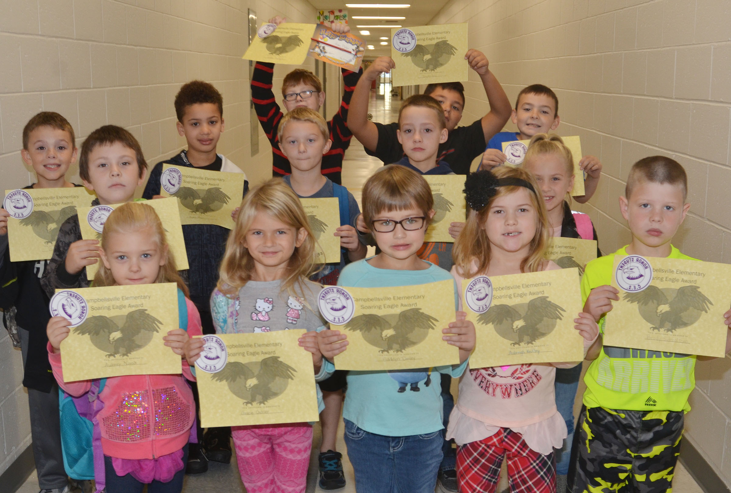 From left, front, are kindergarteners Aubrey Novak and Gracie Gebler, first-grader Addelyn Dooley, kindergartener Aubreigh Knifley and first-grader Brody Sidebottom. Second row, first-grader Fabrizio Segura, second-grader Camren Skaggs, third-grader Caysen Tungate and second-grader Ava Ellis. Back, third-grader Brayden Judd, first-grader Bryant Mayo, third-graders Aidan Phillips ad Brayden Paiz and second-grader Hunter Garmon. Not pictured are kindergarteners Raelin Goddard and Aleja Taylor.