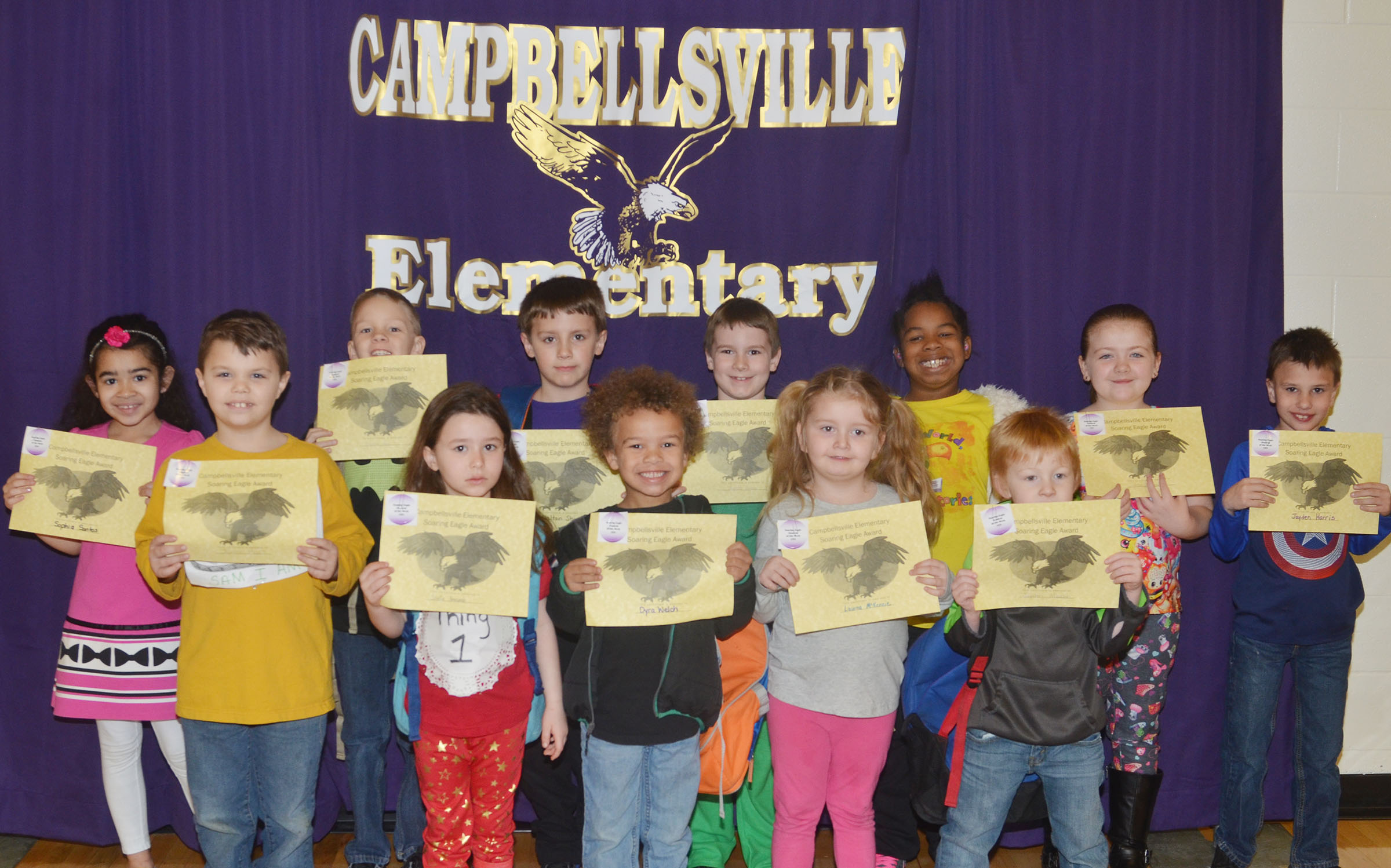 From left, front, are first-graders Jaxson Hunt and Stella Newcomb and kindergarteners Dyra Welch, Laurna McKenzie and Jayden Maupin. Back, second-graders Sophia Santos, Braxton Agee, Dalton Shively and Stephen Green, third-grader KaMiya Williams, first-grader London Whitlow and third-grader Jayden Harris. Absent from the photo are kindergartener Timothy Stacy, first-grader Alexis Mann and third-grader Mary James.