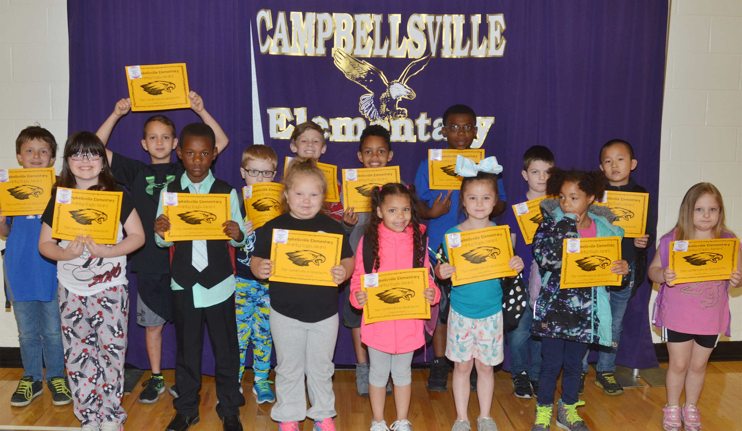 From left, front, are third-grader Lauren Pace, first-grader Lazarick Miller, kindergarteners ReAnna Jeffries and Jasymon Musselwhite, first-grader Molly Wolford and kindergarteners Brea Miller and Scarlett Cook. Back, third-graders Daniel Shively and Bradley Paris, second-graders Aidan Bowles and Isaya Adams, third-graders Anthony Goins and Austin Sloan, first-grader Atticus Strange and second-grader Alex Yang. Absent from the photo is second-grader Lillian Burnett.