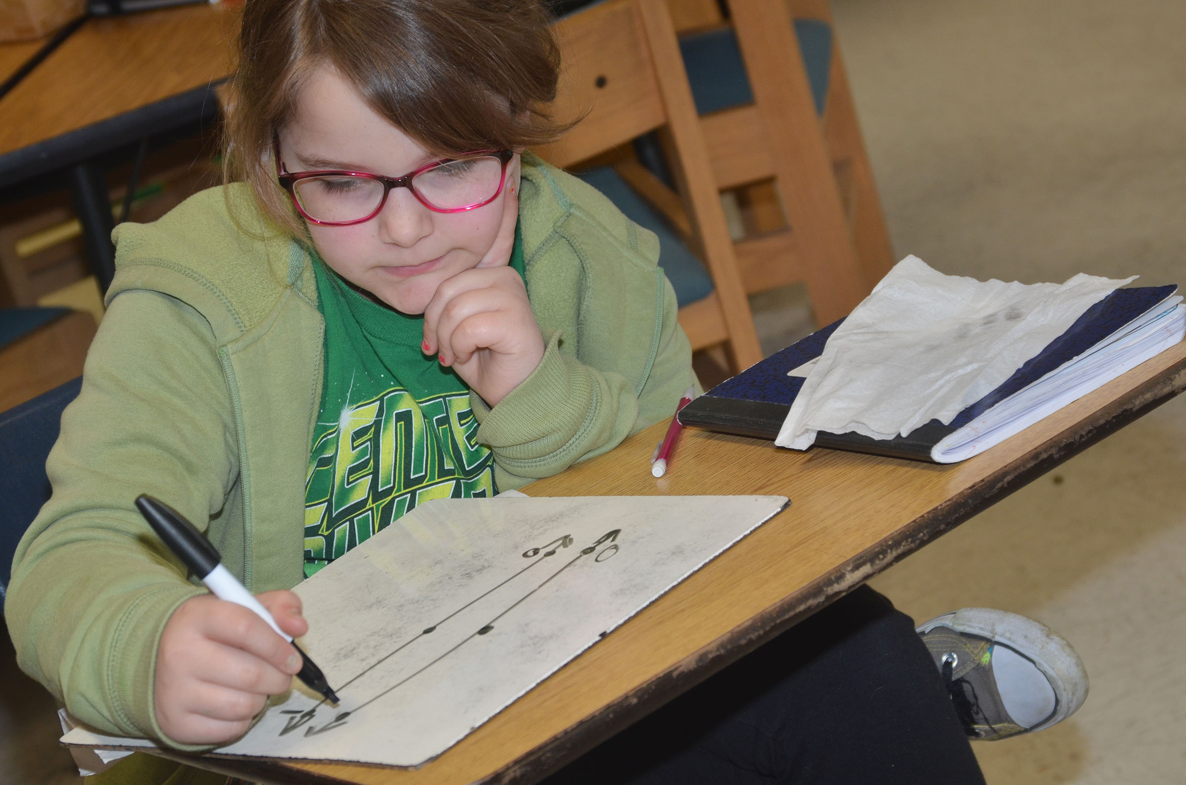 CES third-grader Eleana Brewer adds fractions.