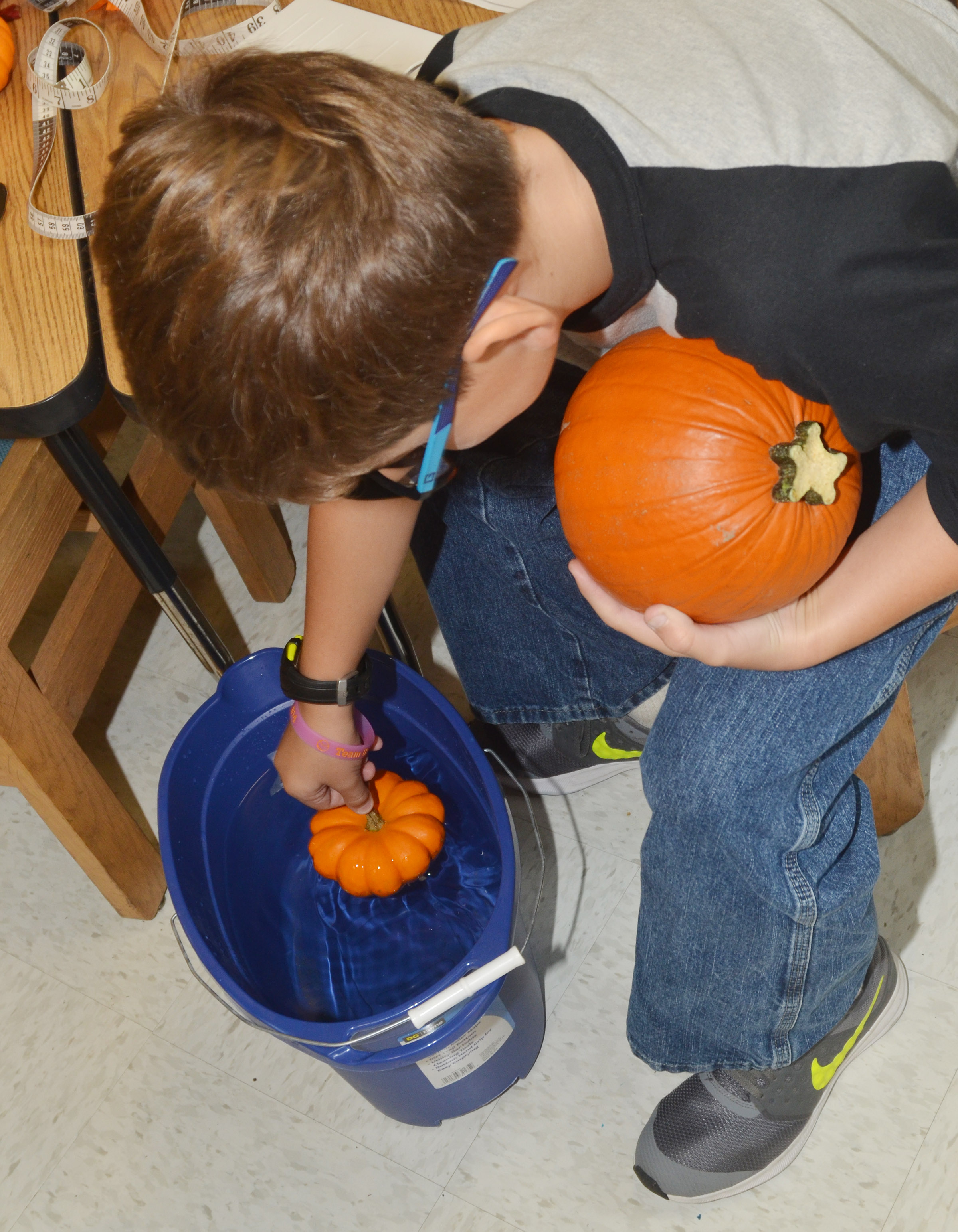 CES third-grader Tye Rhodes sees if his pumpkins float.