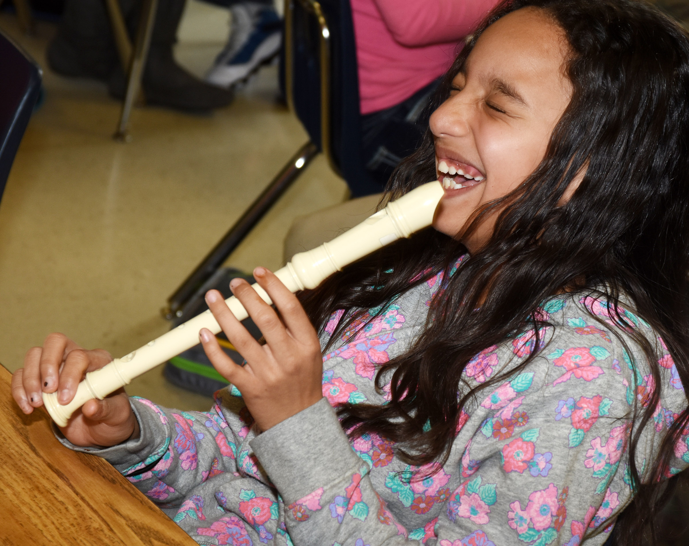 CES fourth-grader Alyssa Knezevic laughs as she plays the recorder.