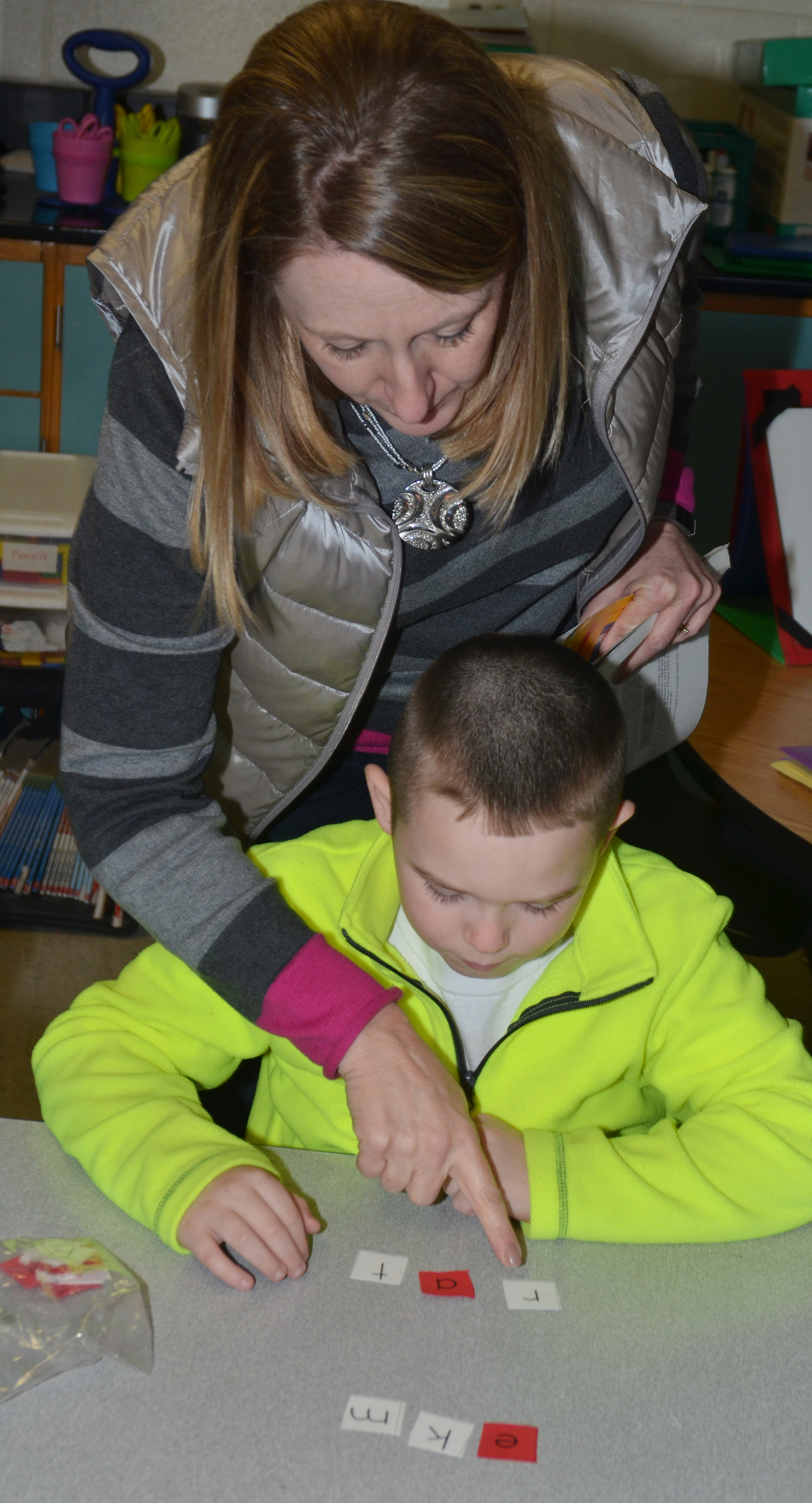 "CES teacher Laura Dicken helps first-grader Colton Maggard spell ""rat."""