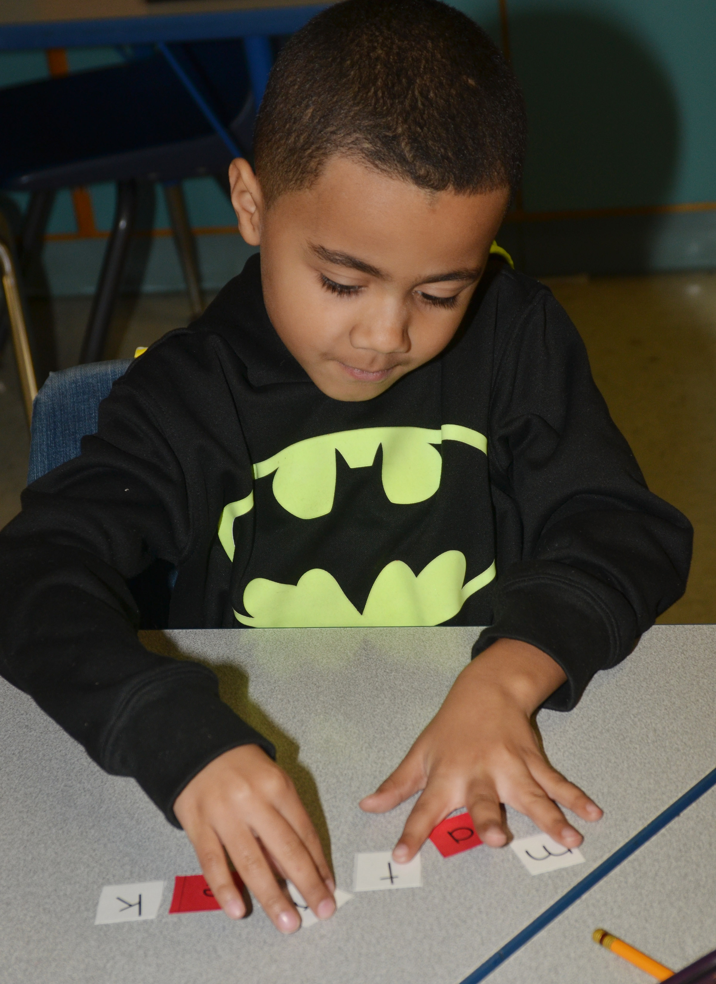 "CES first-grader Trace Richardson jumbles his letters after spelling ""make."""