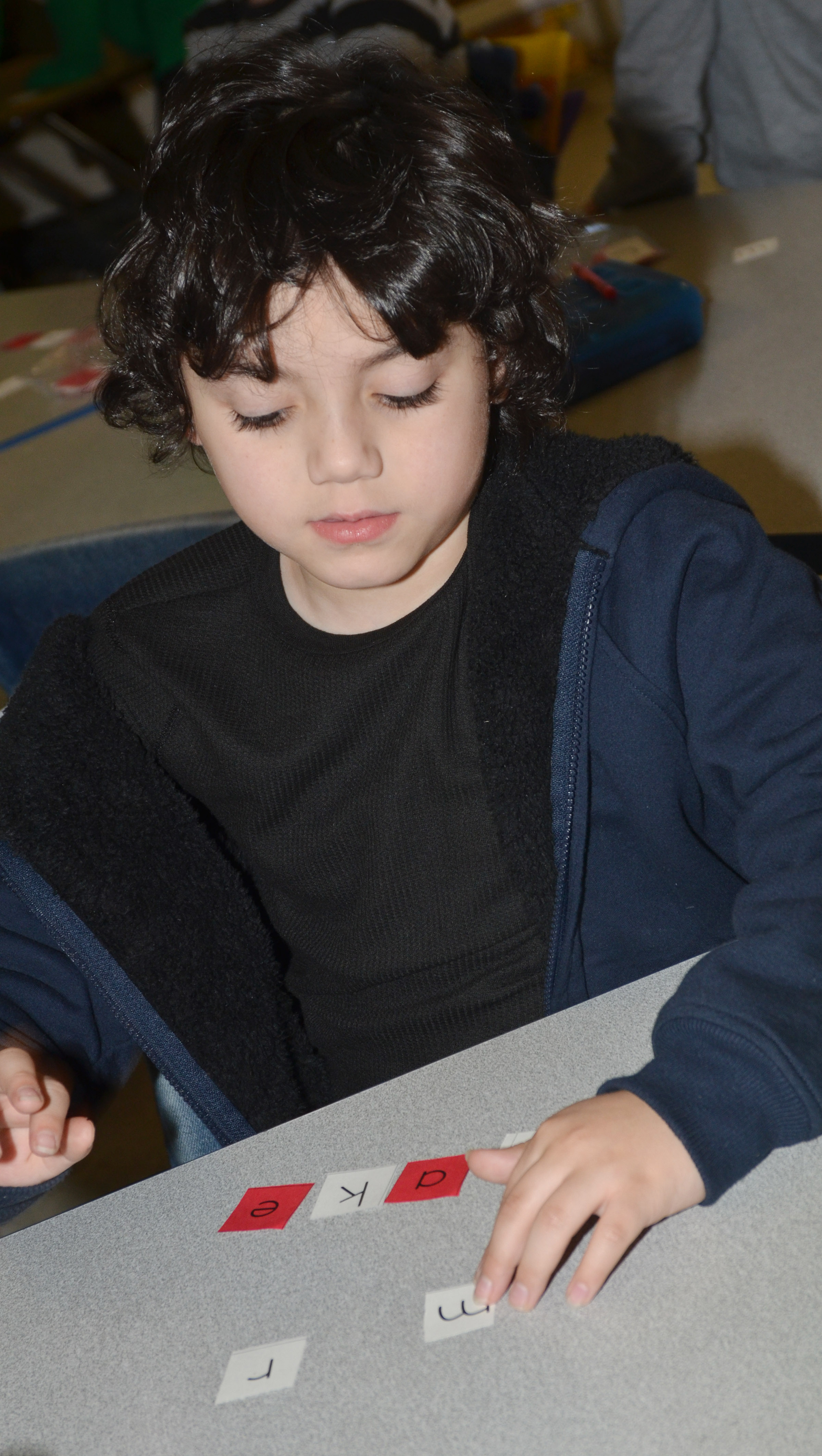 "CES first-grader Diego Aquino spells ""take."""