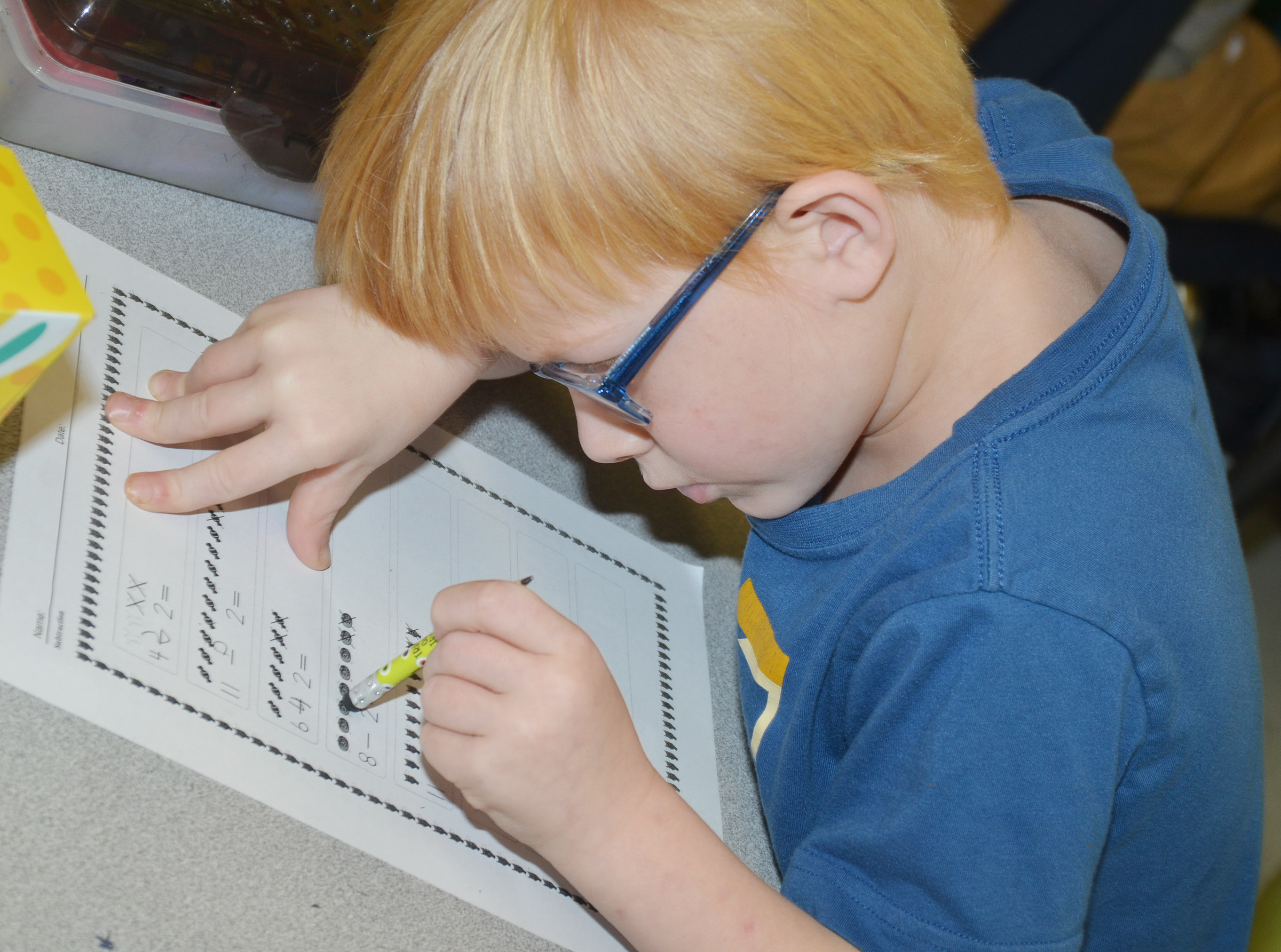 CES first-grader Jayden Maupin works a subtraction problem.
