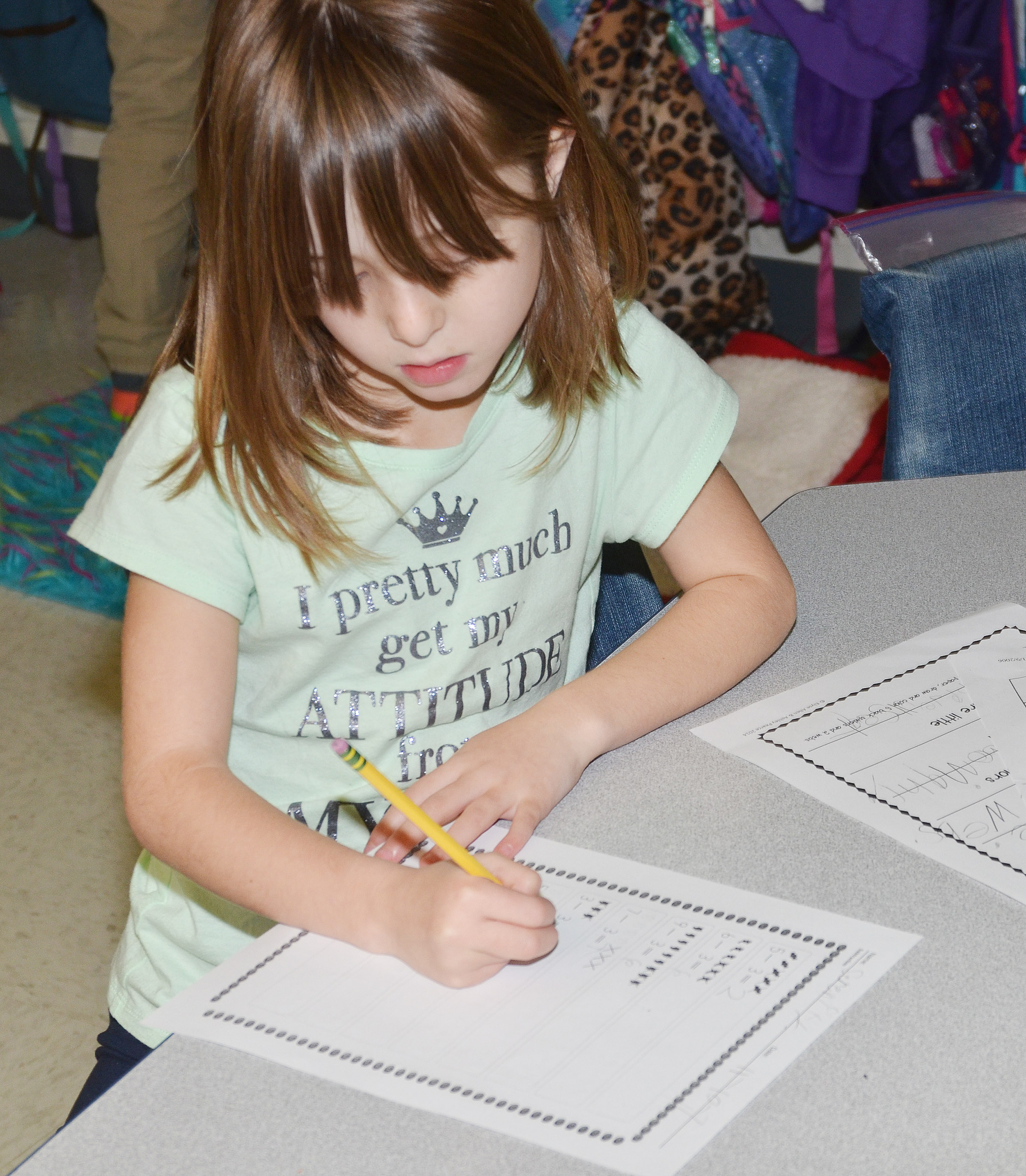 CES first-grader Serenity Bell works a subtraction problem.