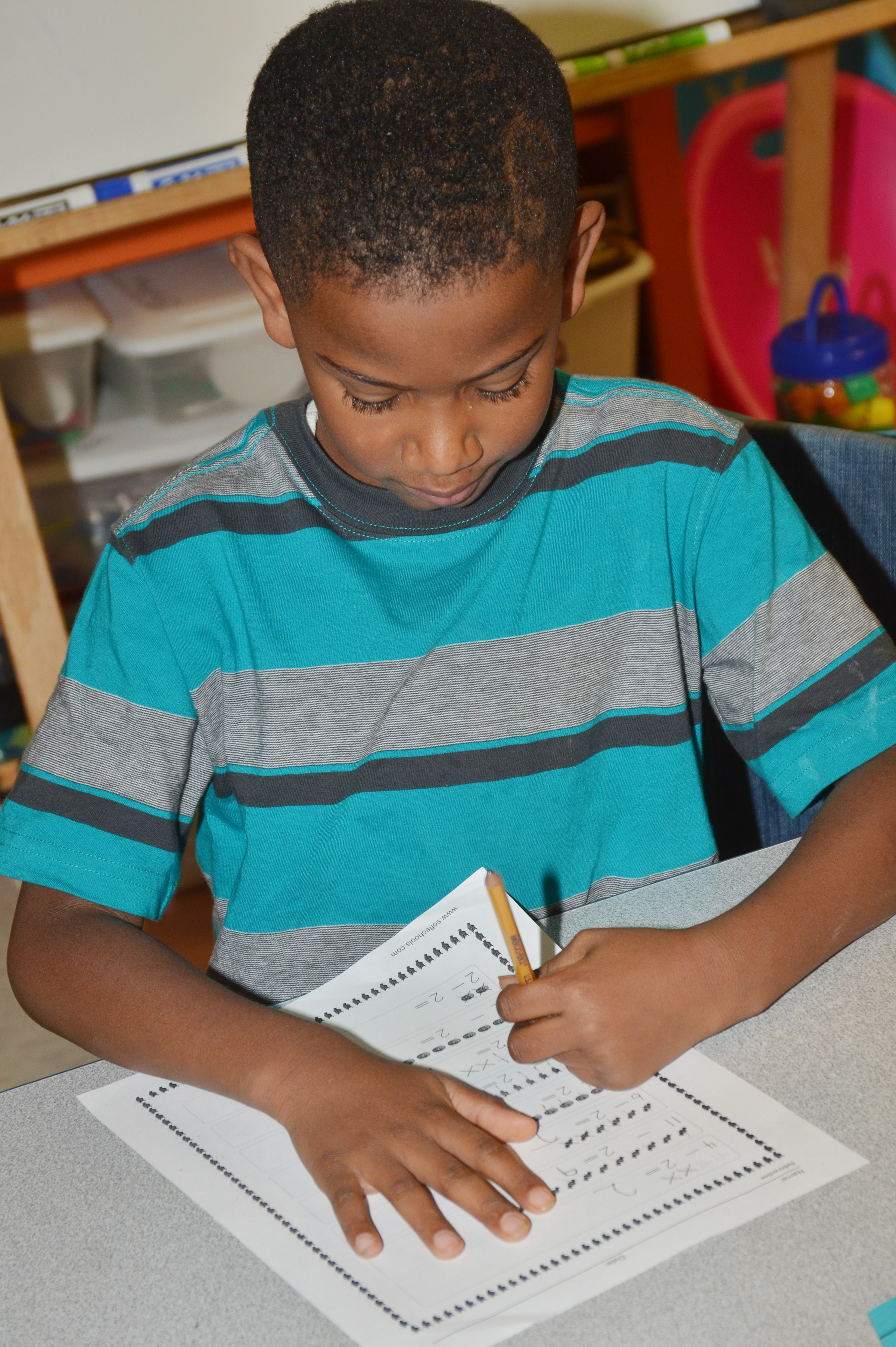 CES first-grader Kasen Smith works a subtraction problem.