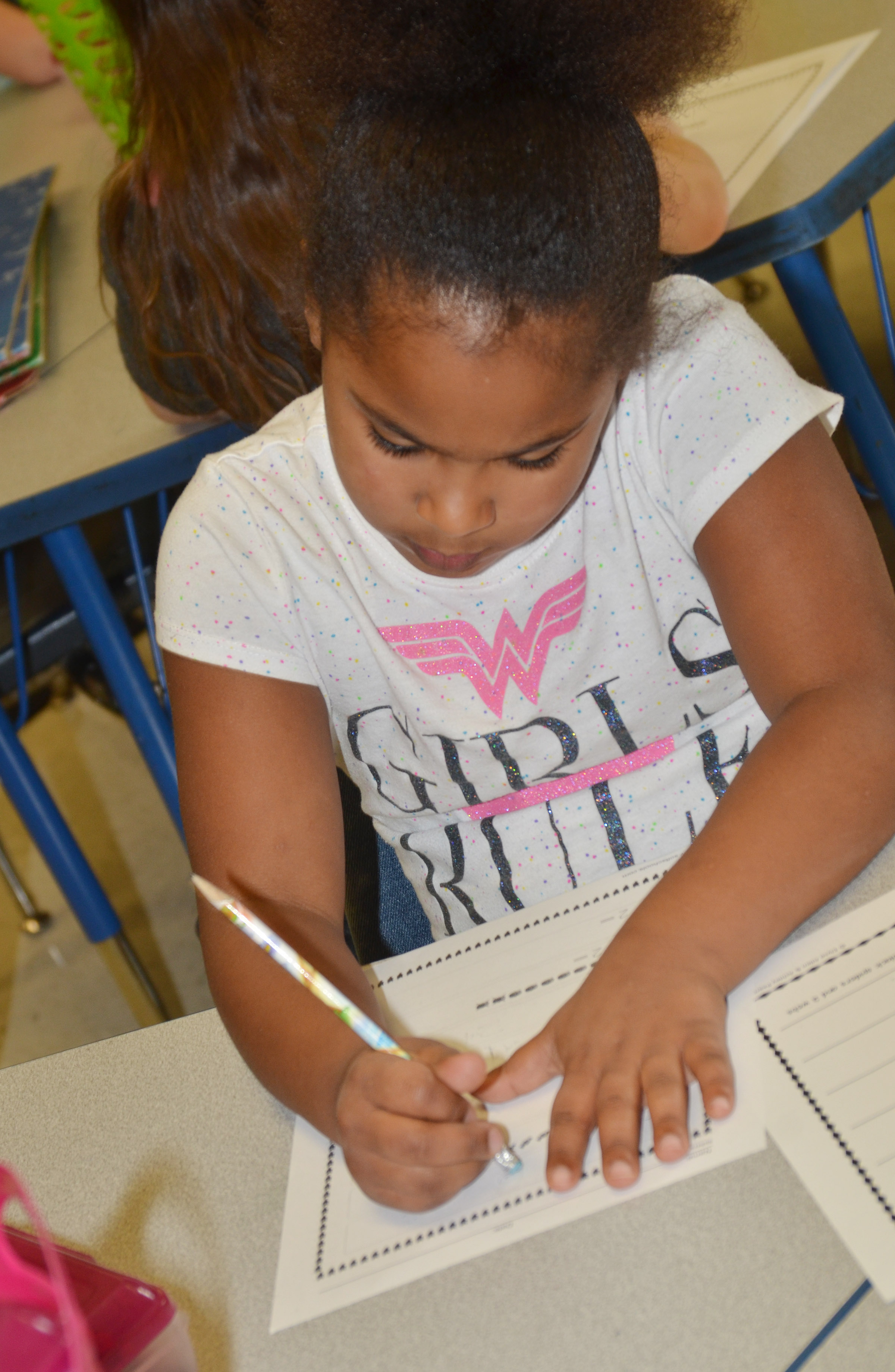 CES first-grader Raelin Goddard works a subtraction problem.