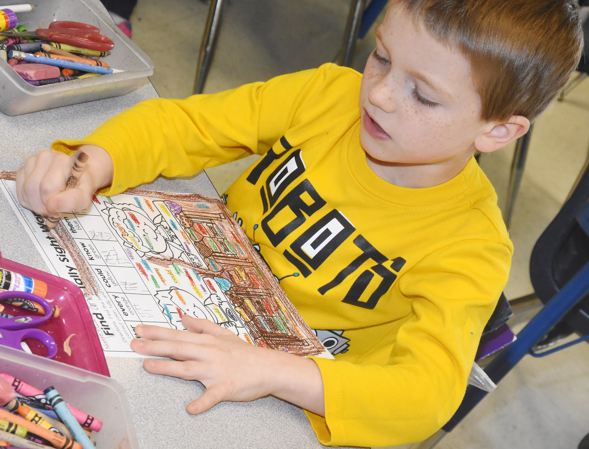 CES first-grader Jason Eggers searches for his sight words.