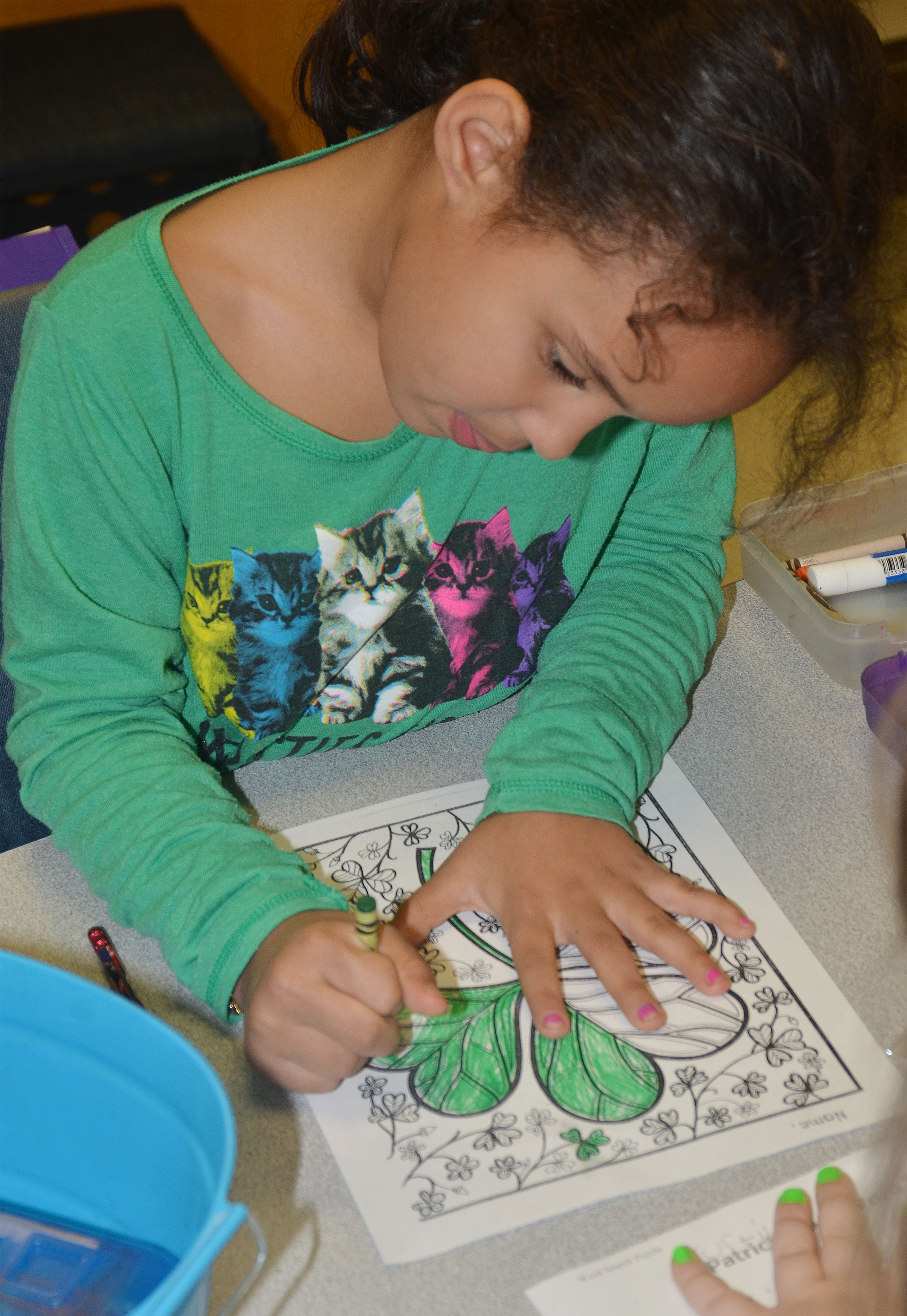CES first-grader Amani Bridgewater colors a shamrock.