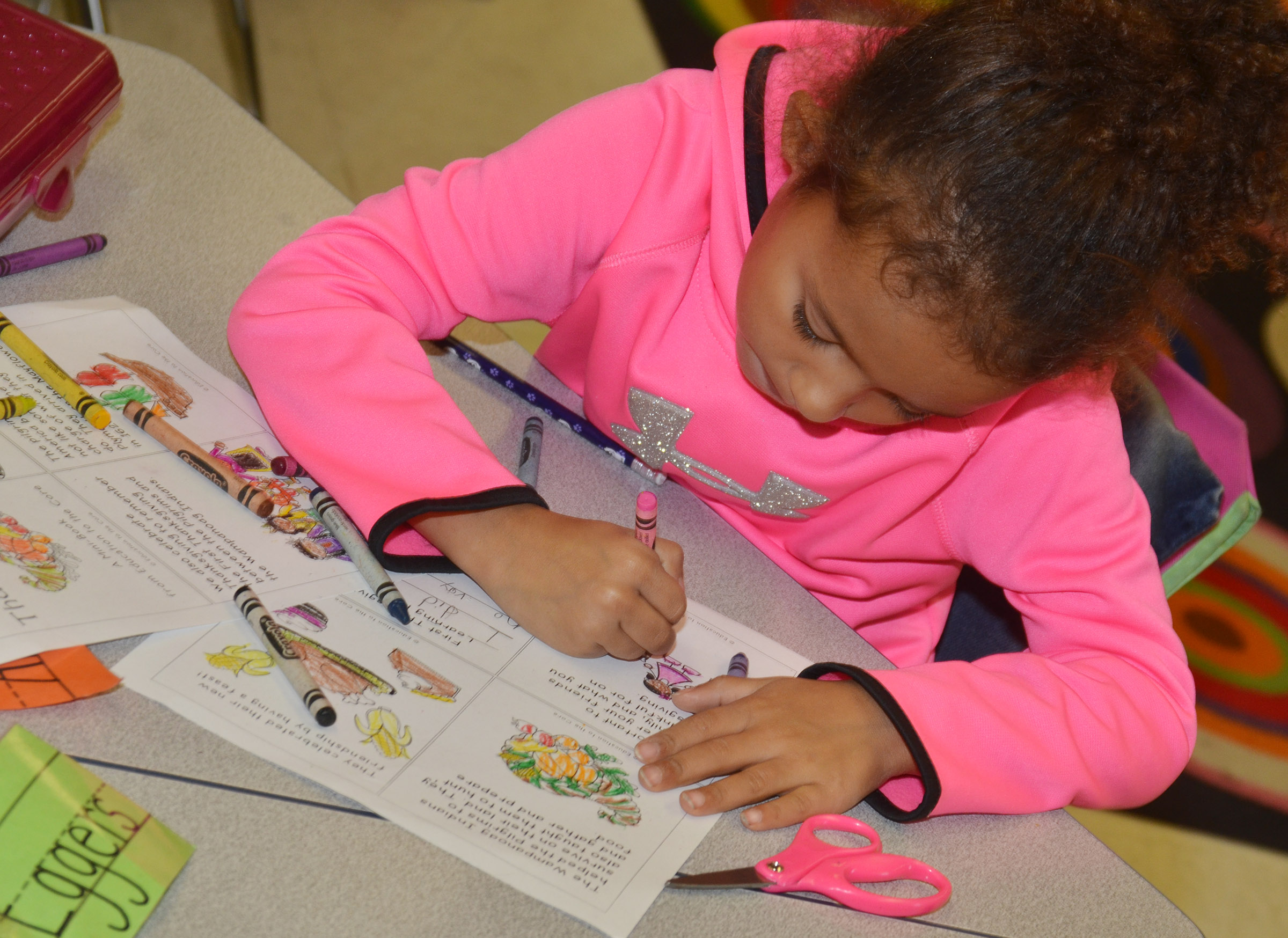 CES first-grader Aleja Taylor colors the pictures in her Thanksgiving book.
