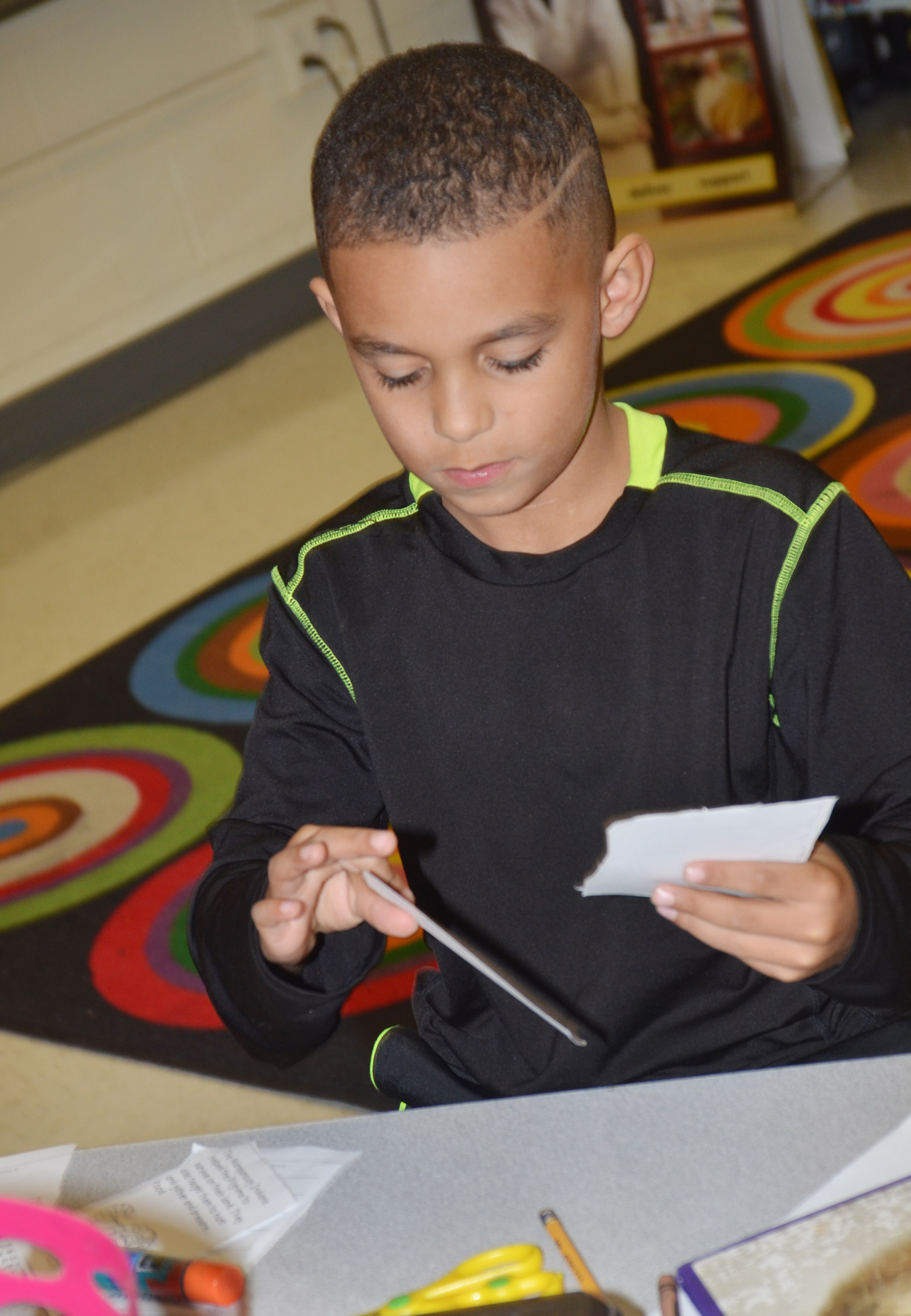 CES first-grader Quincy Travis puts his Thanksgiving book together.