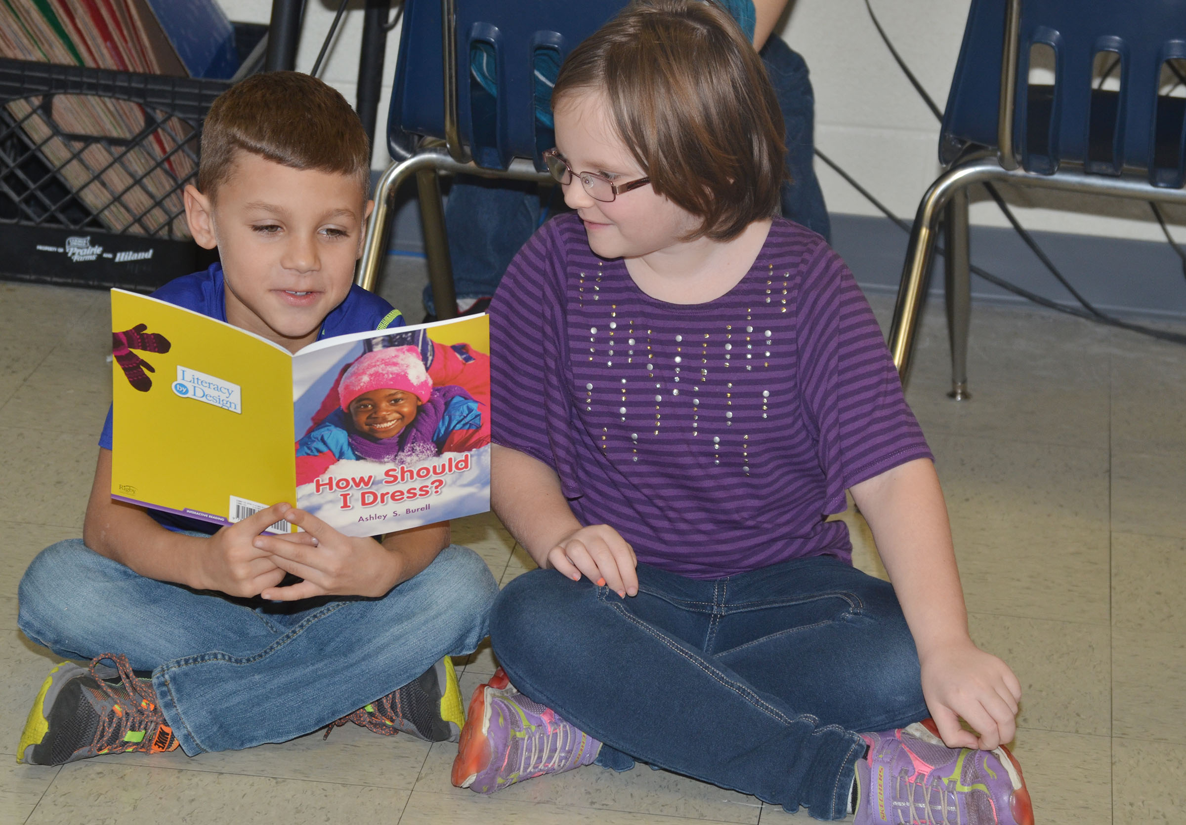 CES first-grader Shylan Dunn, at left, reads with classmate Justice Albrecht.