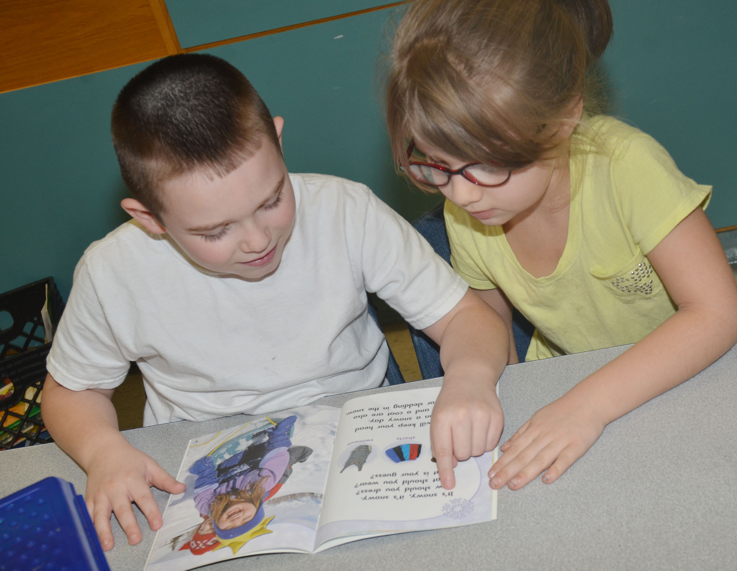 CES first-graders Colton Maggard, at left, and Kenady Hayes read together.