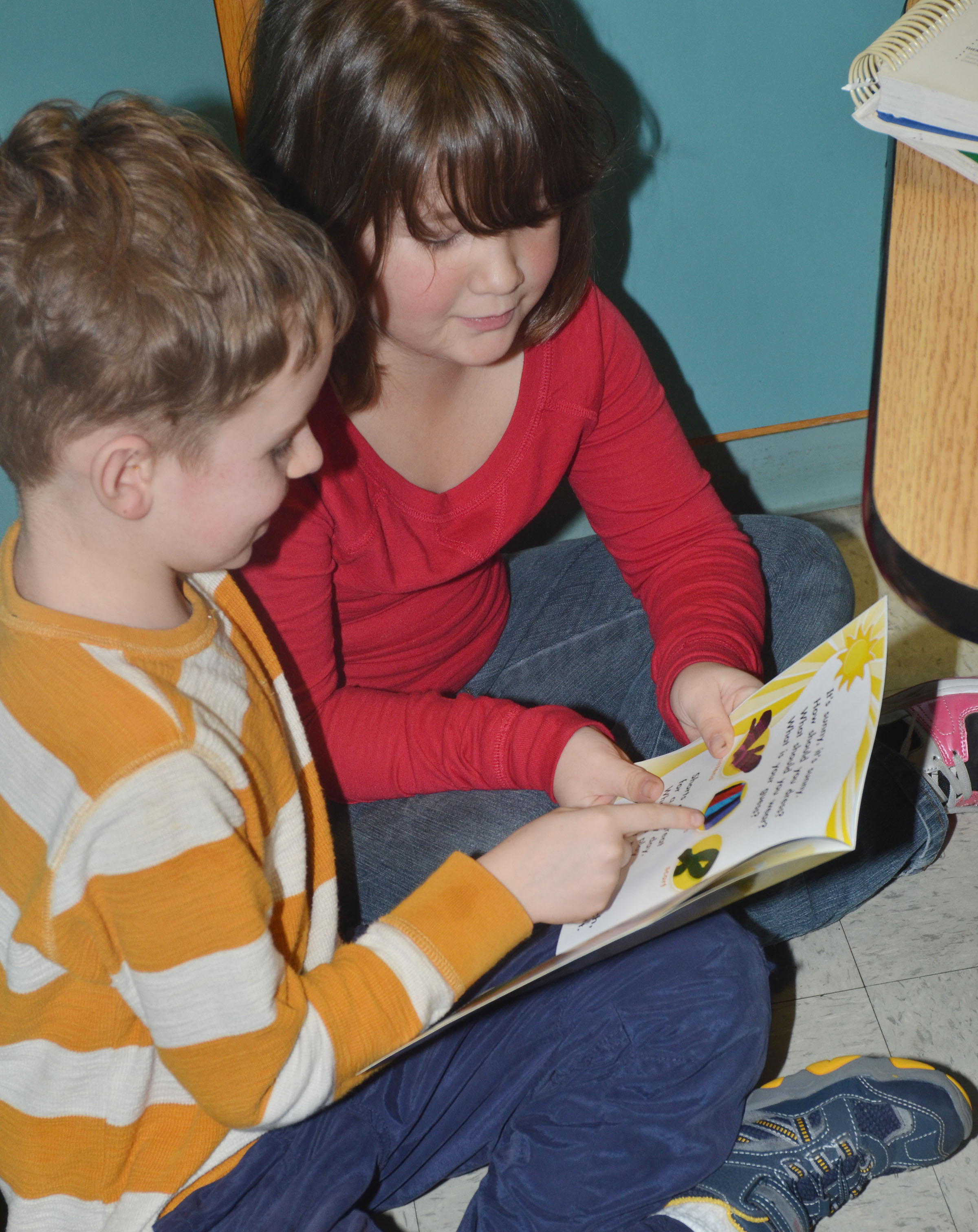 CES first-graders Jayden Cox, at left, and Destiny Rhinehart read together.
