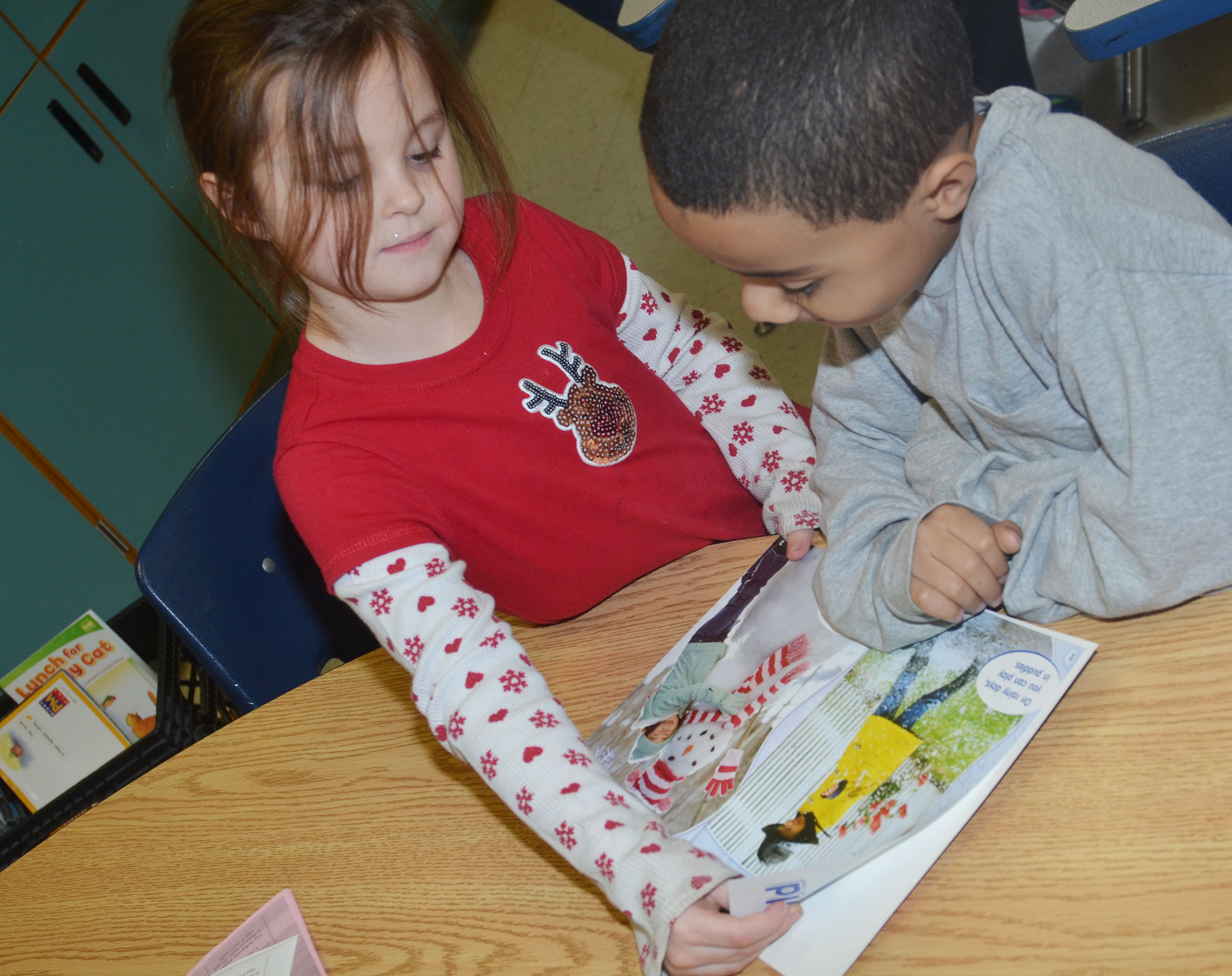 CES first-graders Molly Wolford, at left, and Daniel Richardson read together.