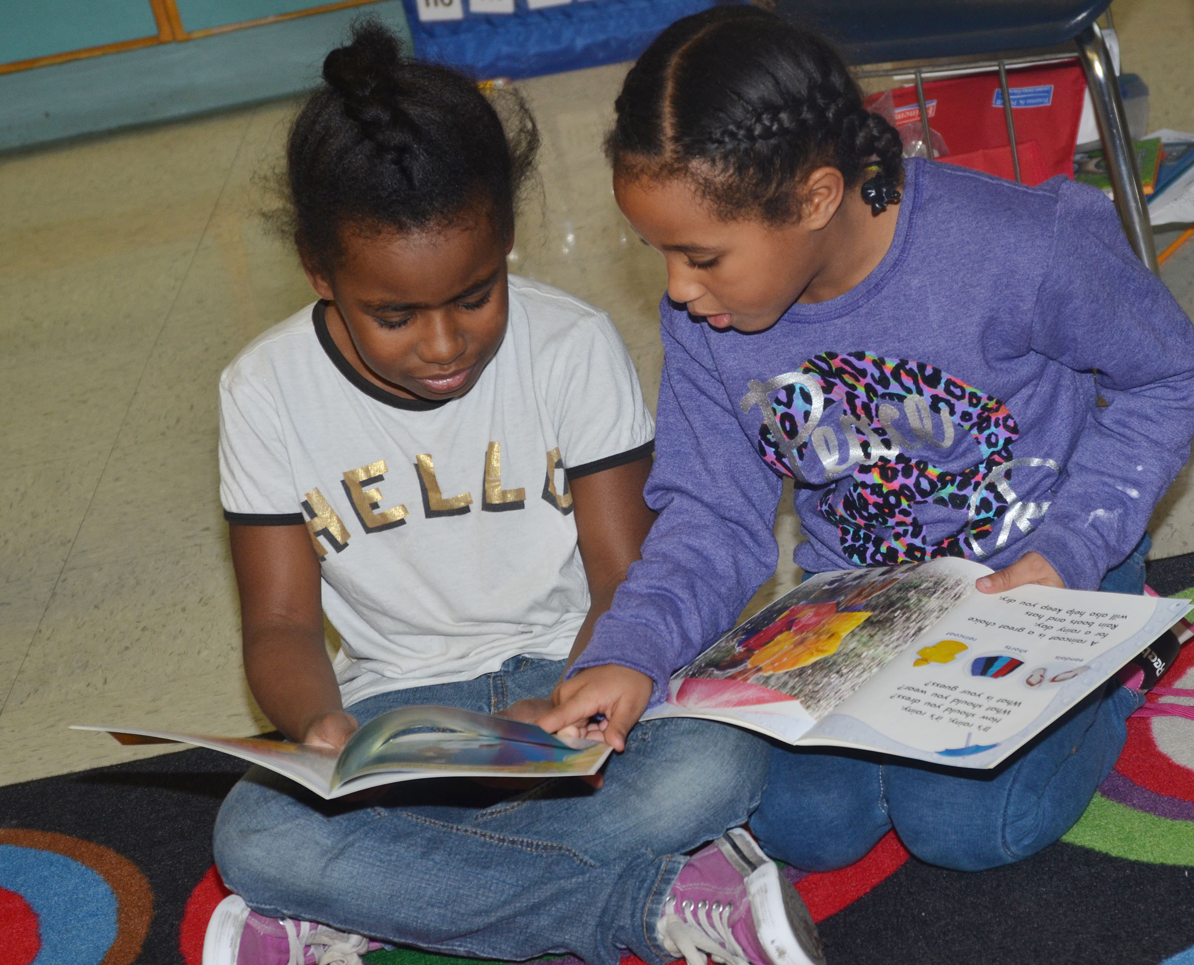 CES first-graders Destini Gholston, at left, and Kadance Ford read together.