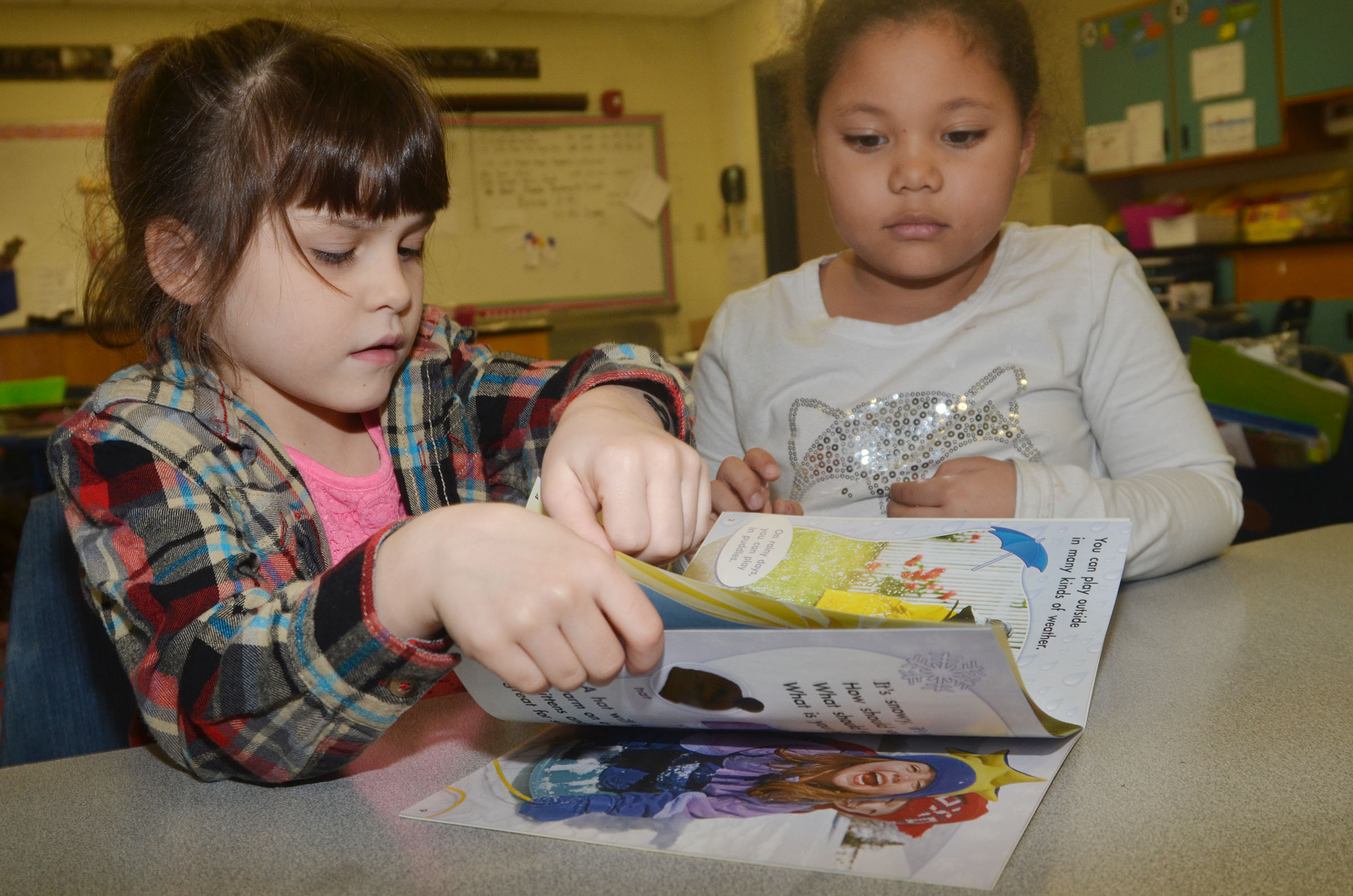 CES first-graders Phoebe Ritchie, at left, and Briana Wooley read together.