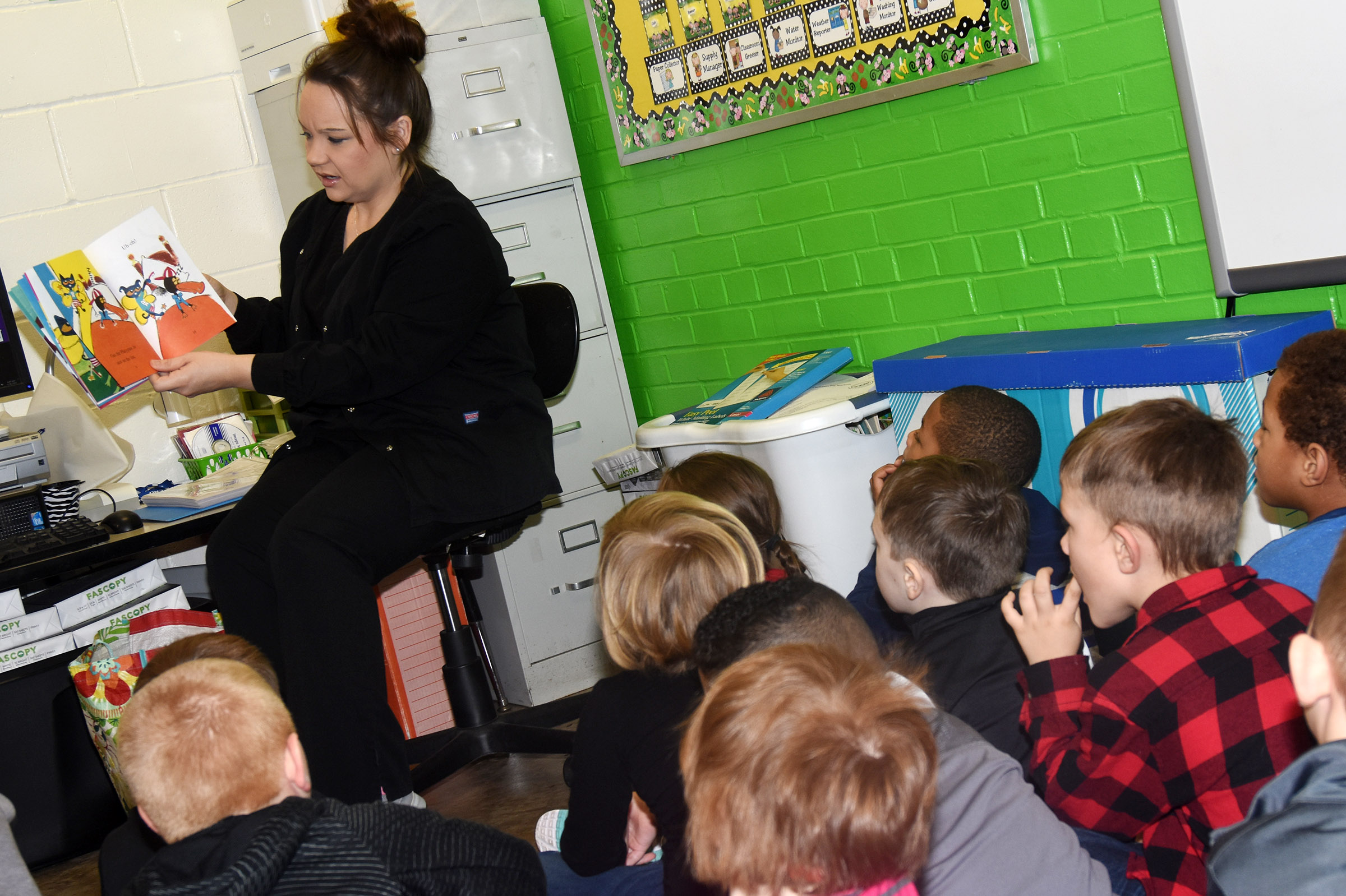 "Dental hygienist Brandie Sharp, who works at Dr. John Smoot's dental office in Campbellsville, reads ""Pete the Cat and the Lost Tooth"" to CES kindergarteners."