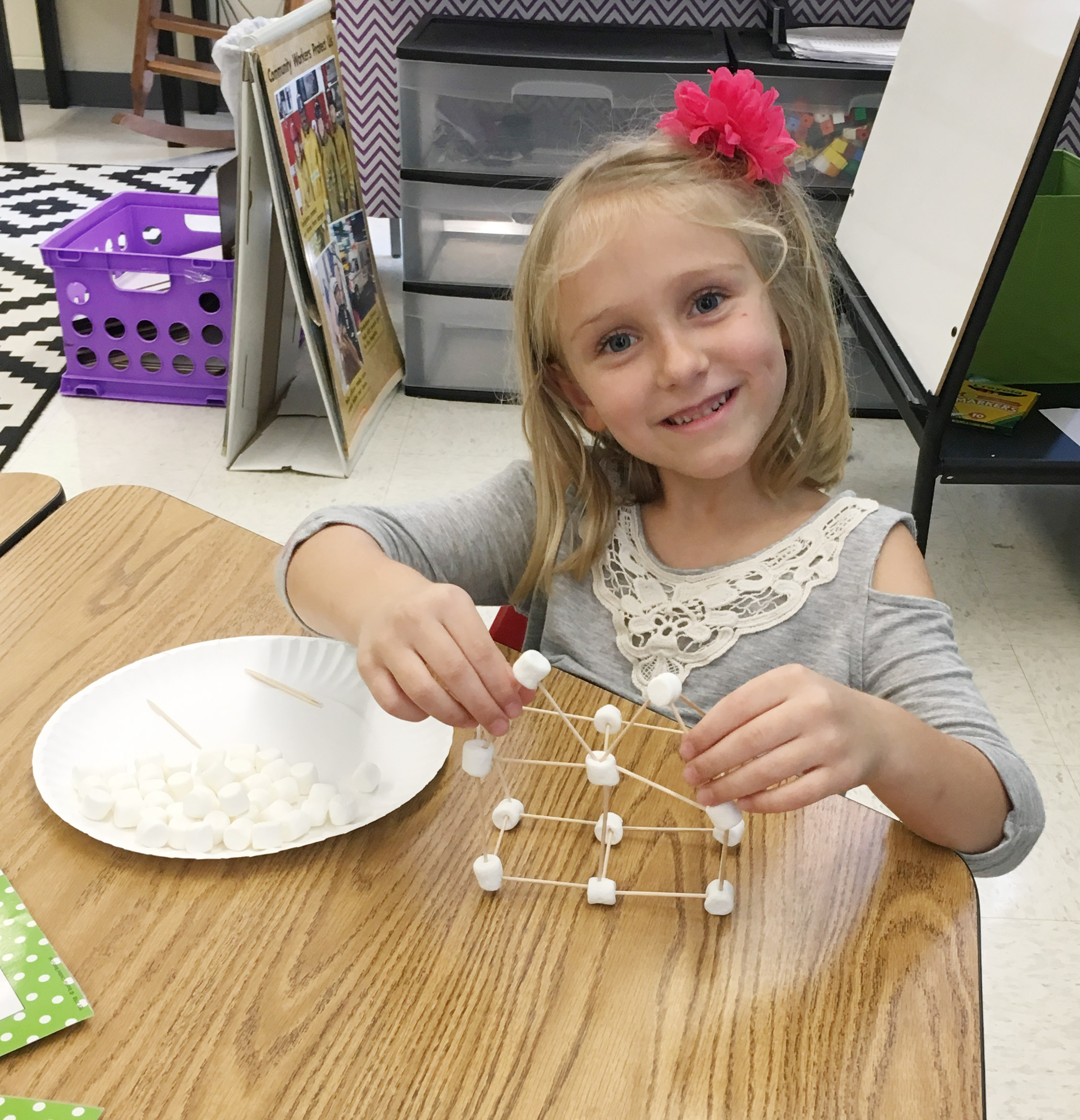 CES first-grader LeeAnna Garvin builds her marshmallow structure.