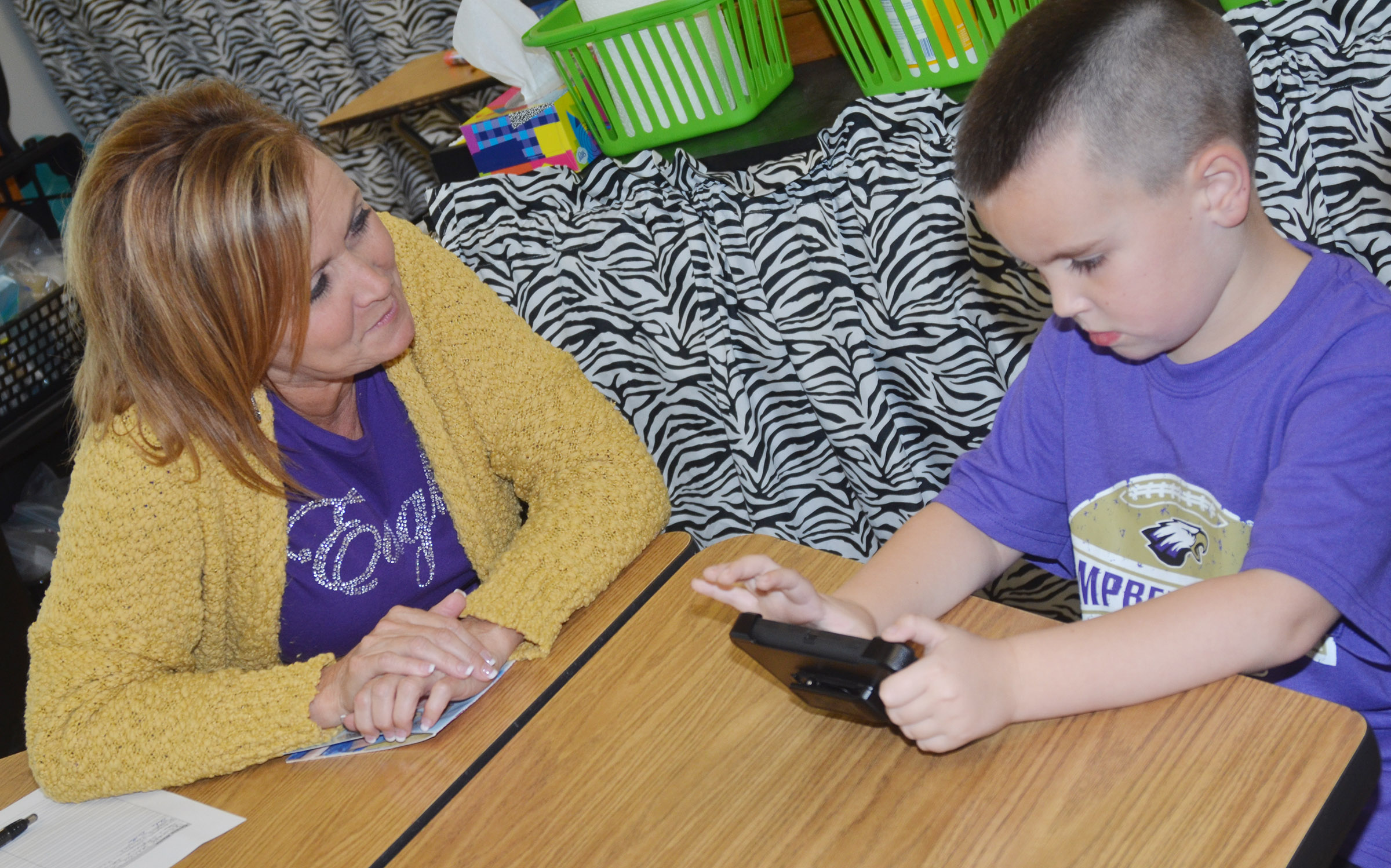 CES kindergarten teacher Lisa Wiseman talks to Xander Britton.
