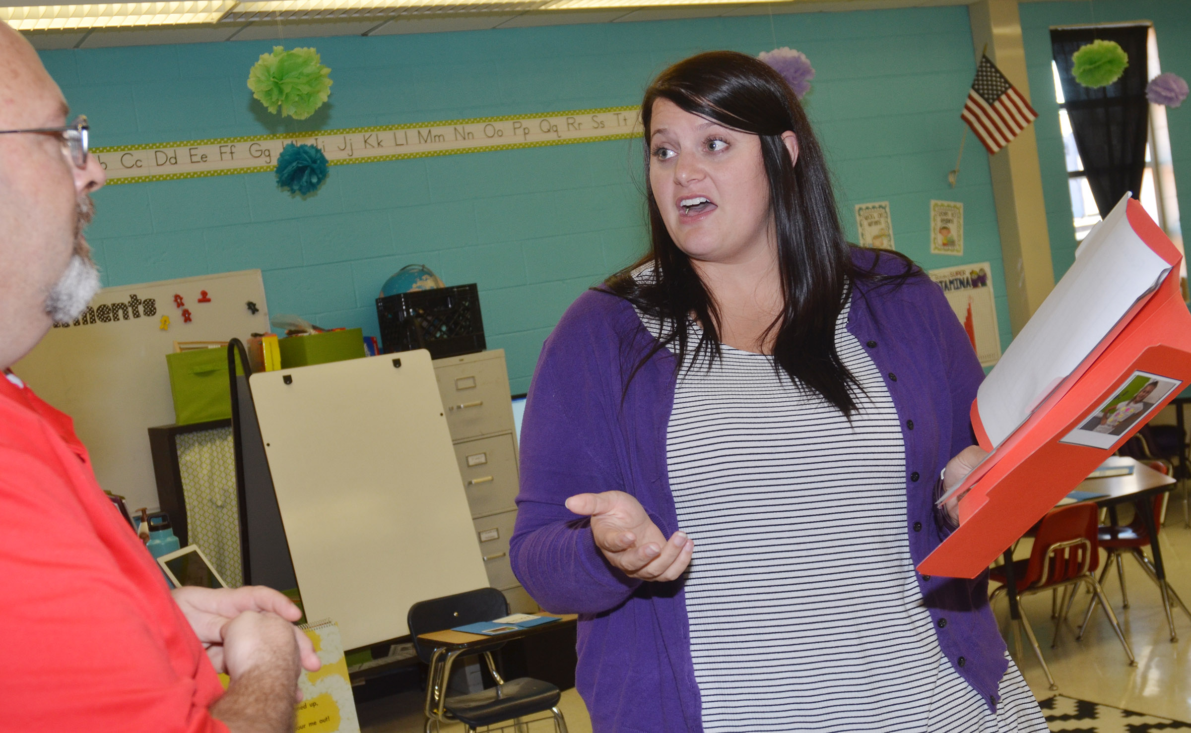 CES first-grade teacher Miriah Cox talks with a parent.