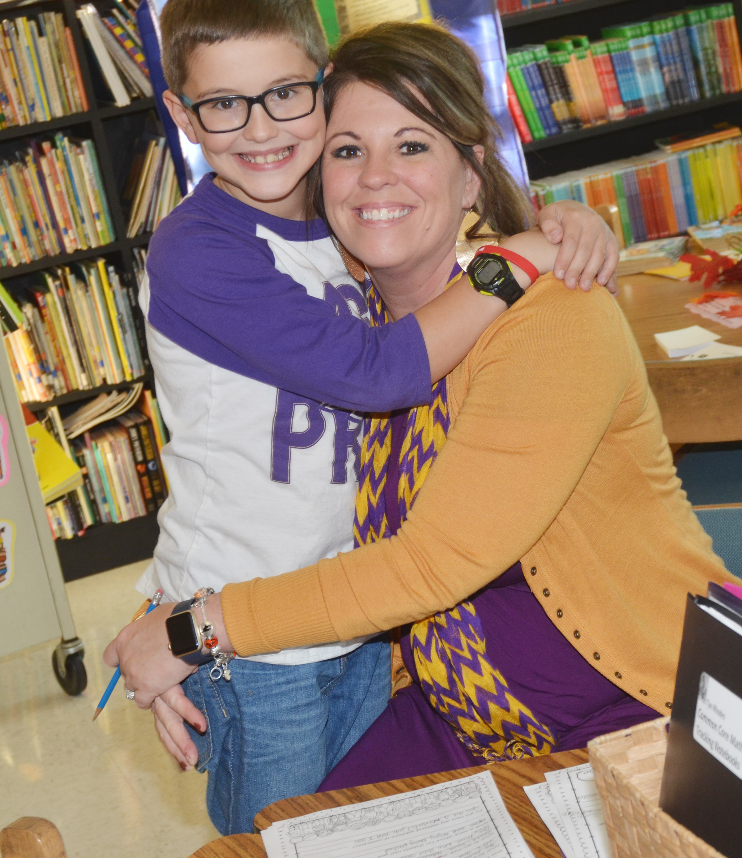 CES third-grader Tye Rhodes talks to his mother, CES Principal Elisha Rhodes, about his grades.