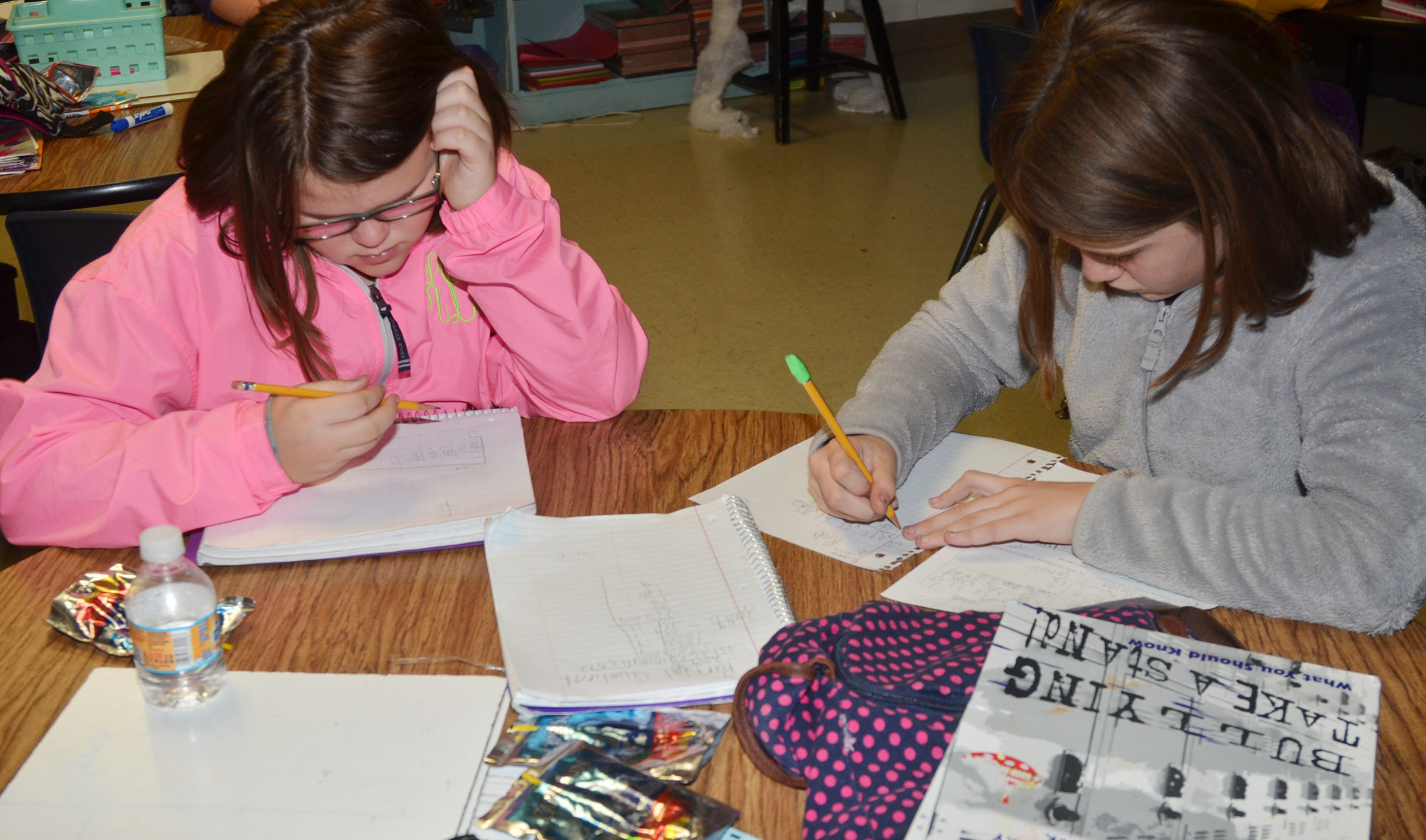 CES fifth-graders Keeley Dicken, at left, and Summer Cothern work on their homework.