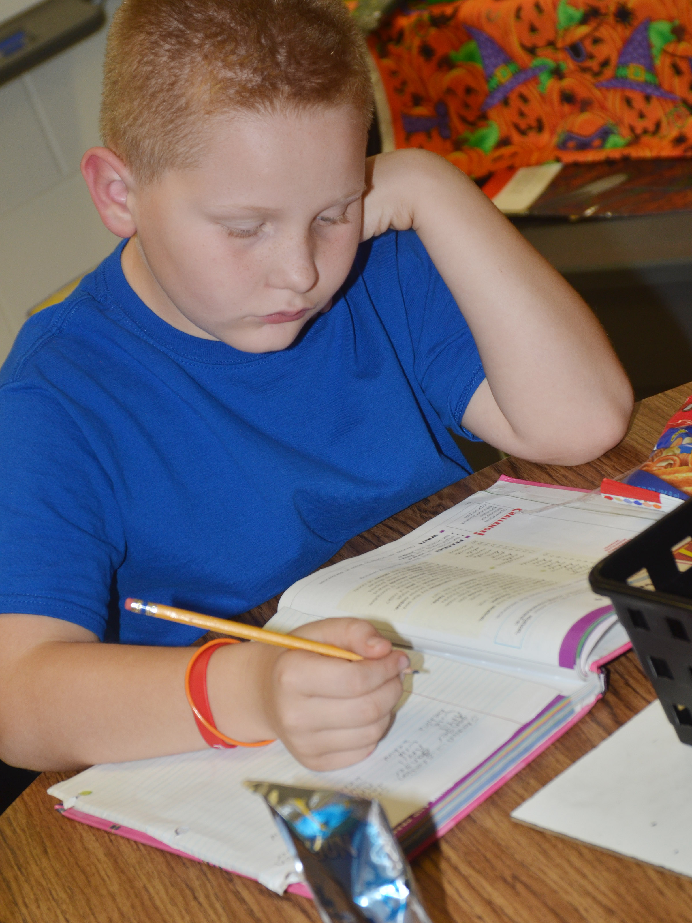 CES fourth-grader Isaiah Jeffries works on his homework.