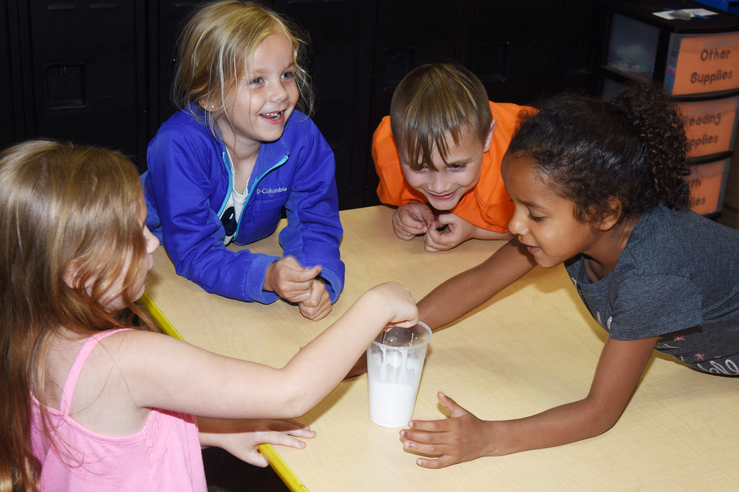 CES kindergartener Trinidy Gribbins, center, and her classmates mix ingredients to make slime.