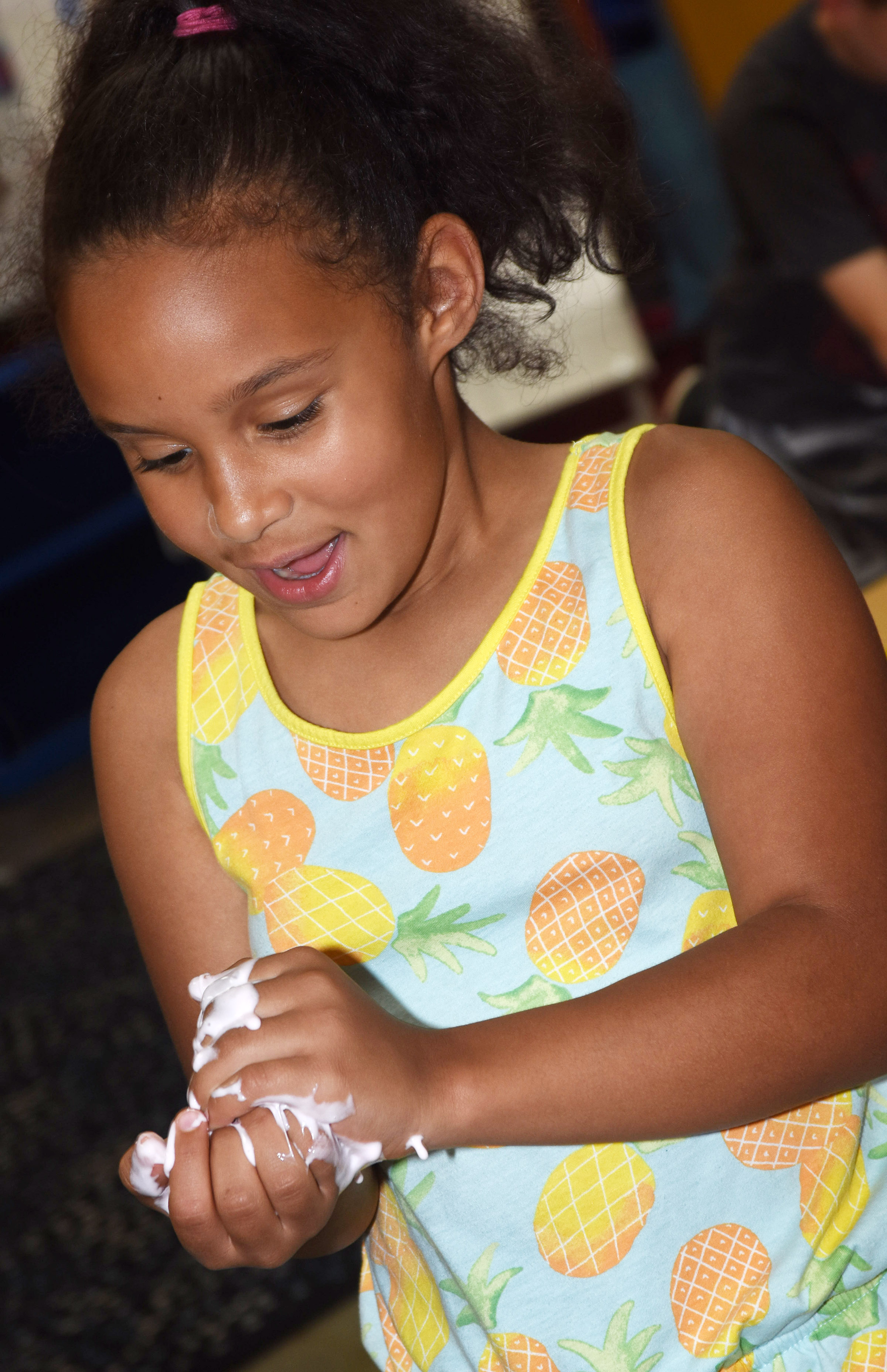 CES second-grader Amani Bridgewater plays with her slime.