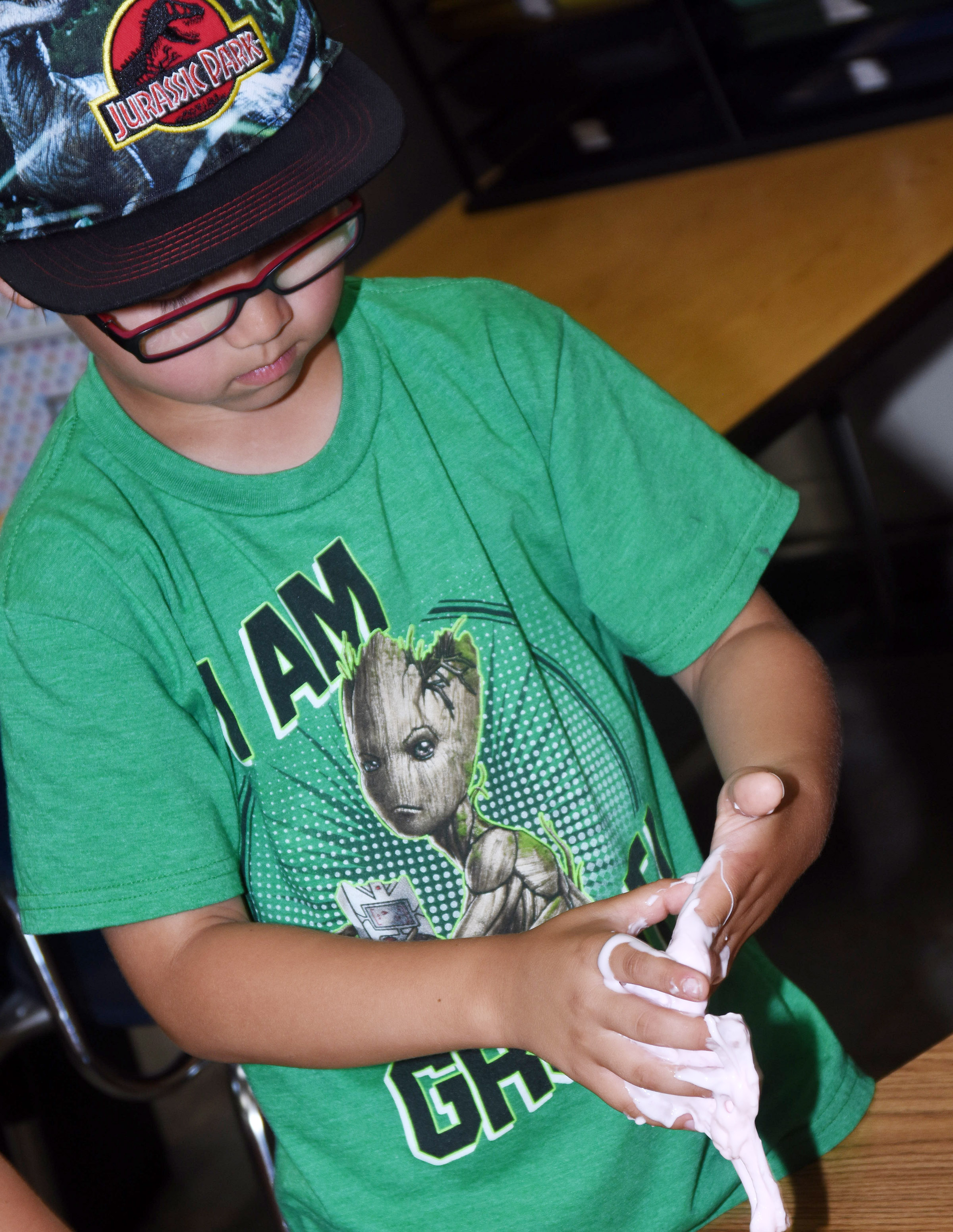 CES kindergartener Victrin Ramsey plays with his slime.