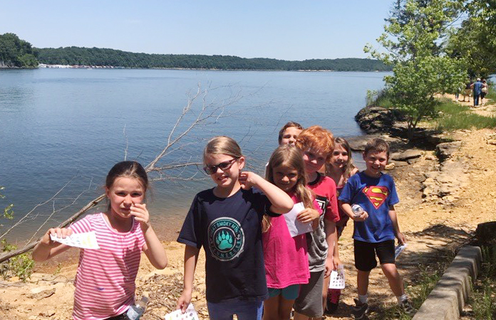 CES students pose for a photo by Green River Lake.