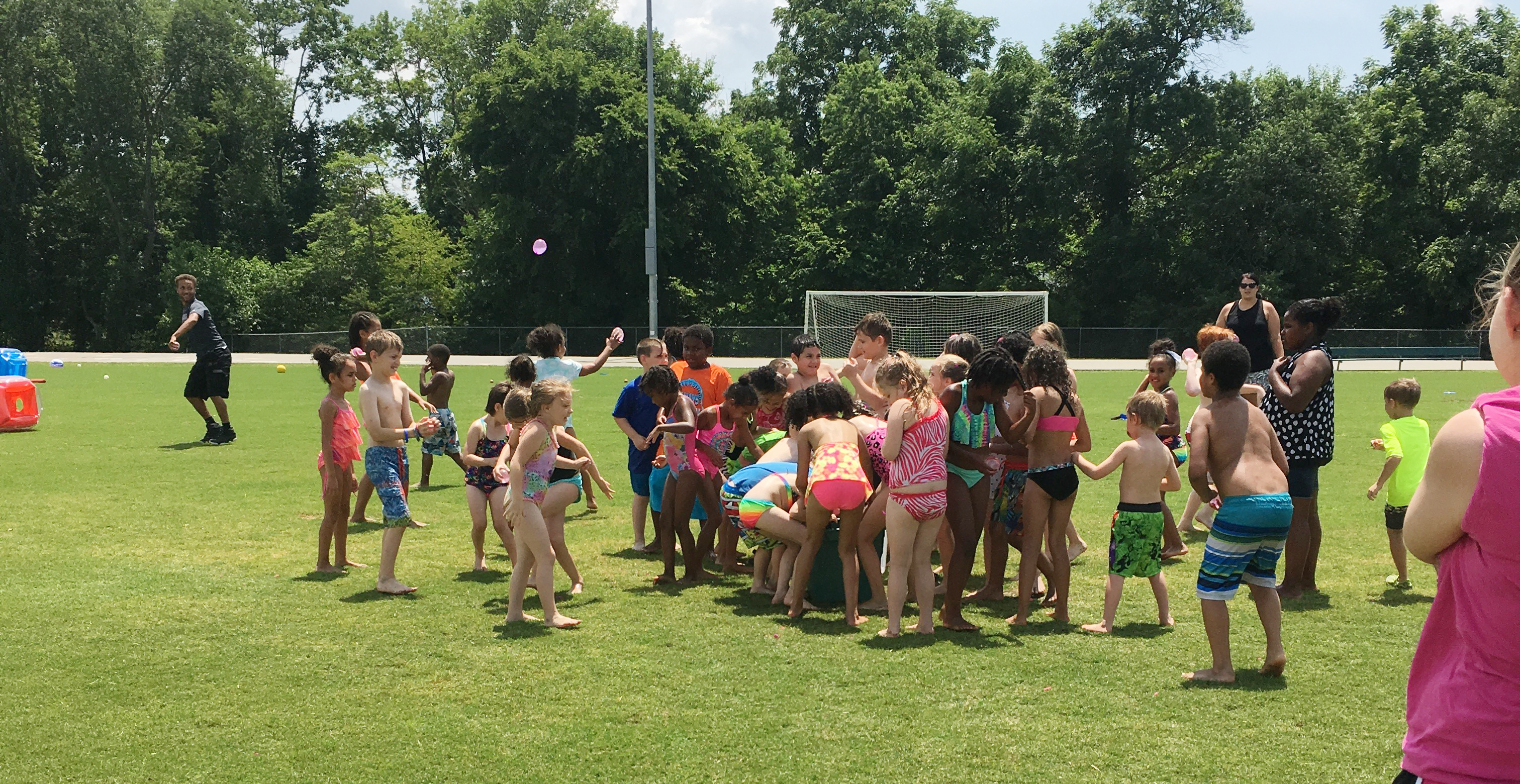 CES students have a water balloon fight to keep cool.