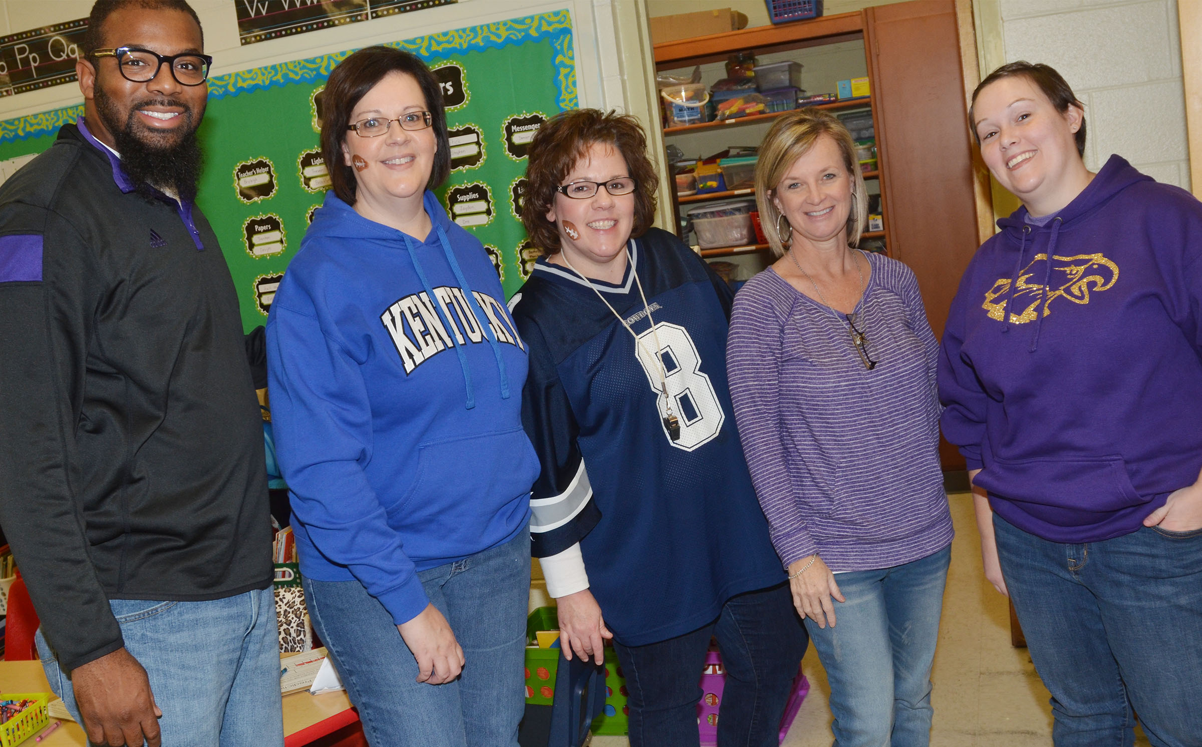 From left, CES special education teacher Will Griffin, second grade teachers Tonya Hagan, Tracey Rinehart and Melanie Cox and Wings Express Director Amanda Barnett take a photo at the second-grade Super Bowl party.