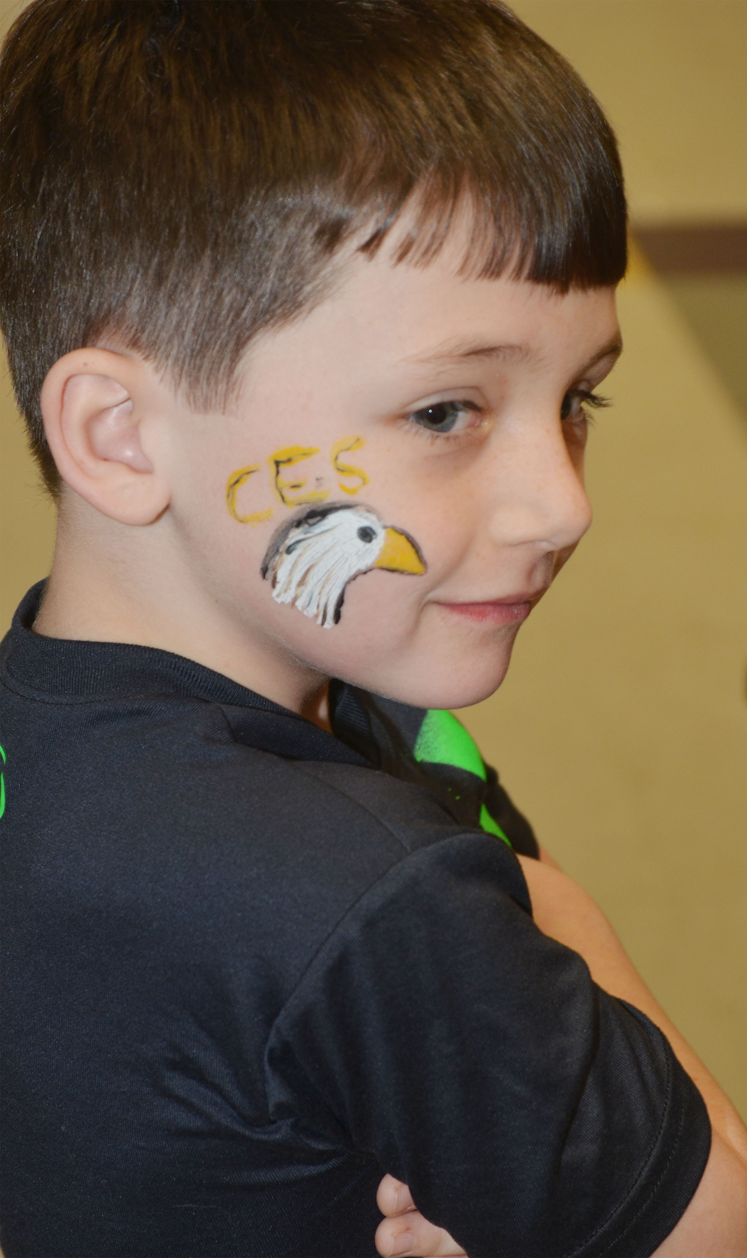 CES second-grader Codey Parks smiles after having an eagle painted on his cheek.
