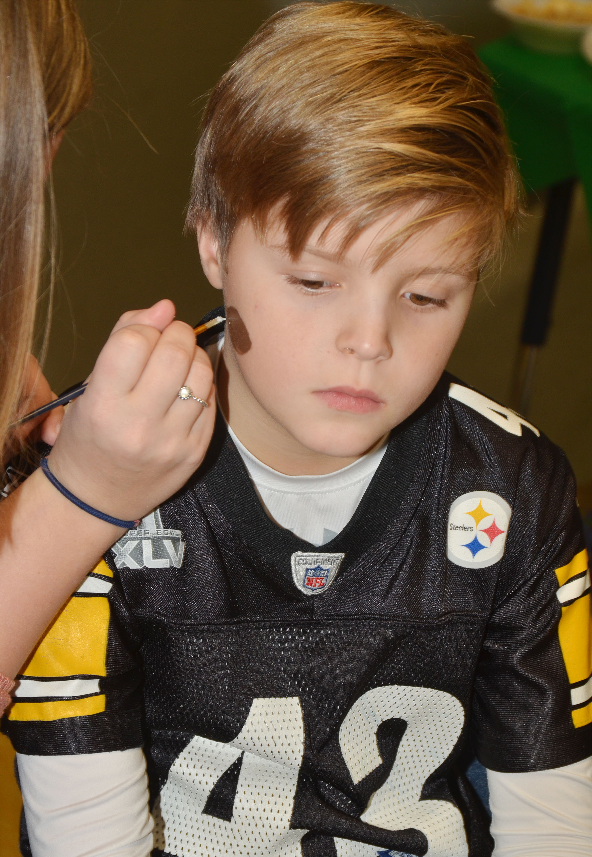 CES second-grader Emerson Gowin has a football painted on his cheek.