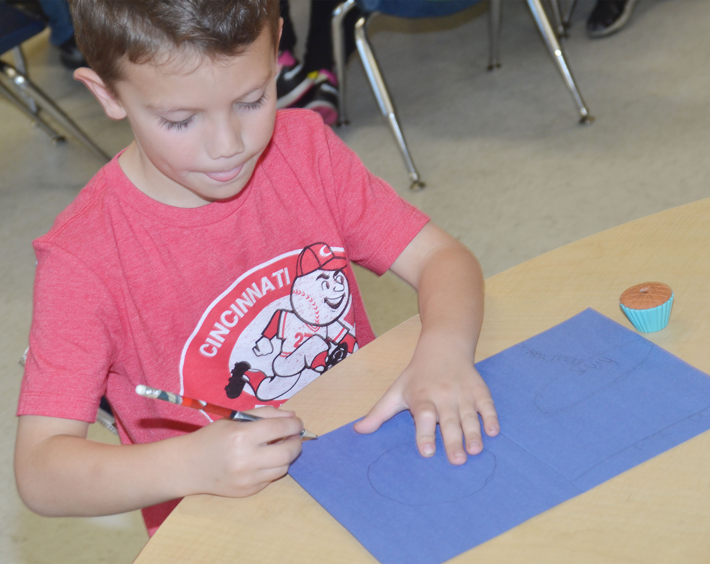 CES first-grader Owen Skaggs makes a card for a third-grade student.
