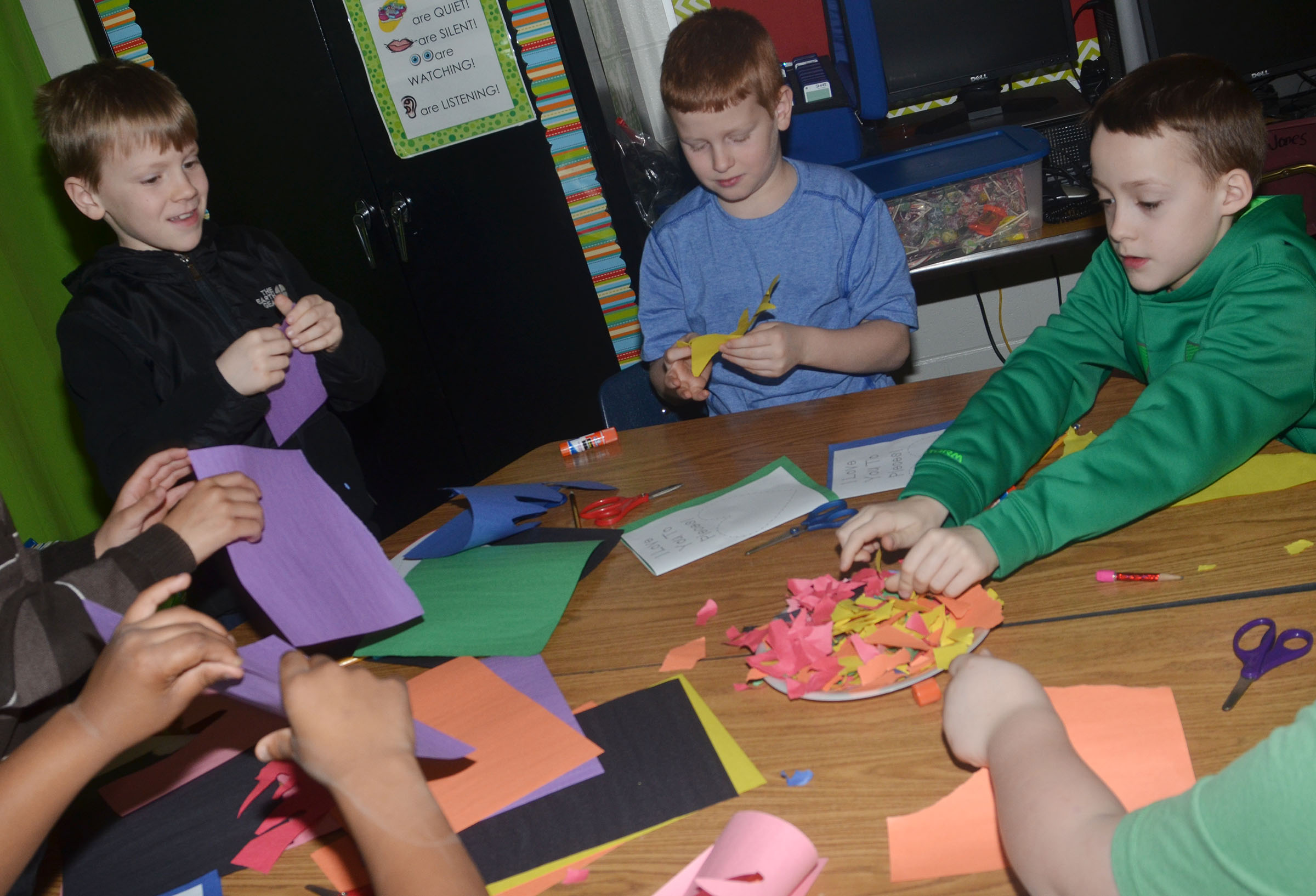 From left, CES third-graders Connor Coots, Westin Dudgeon and Caysen Tungate make their Valentine cards.