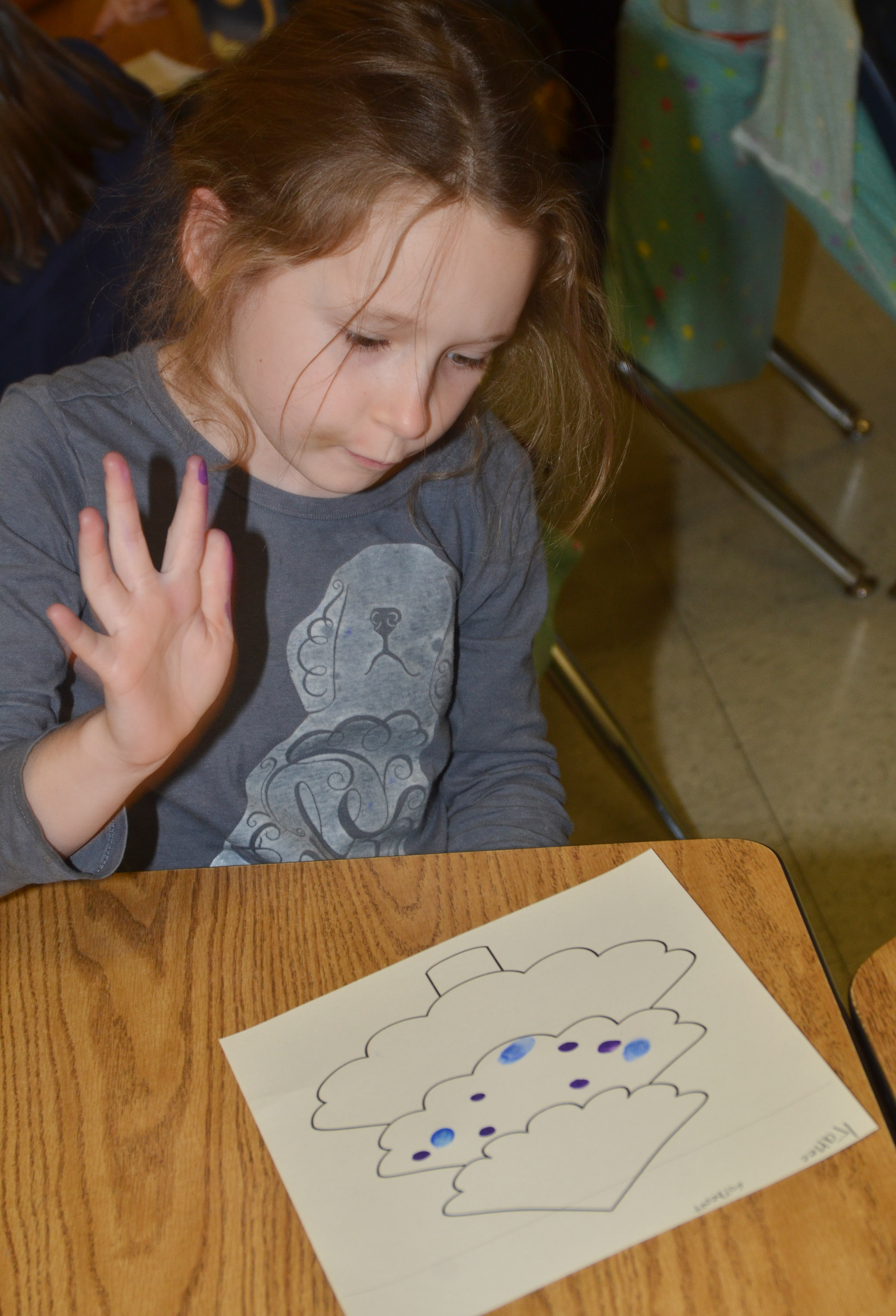 CES first-grader Kaylee Gayheart paints her Christmas tree.