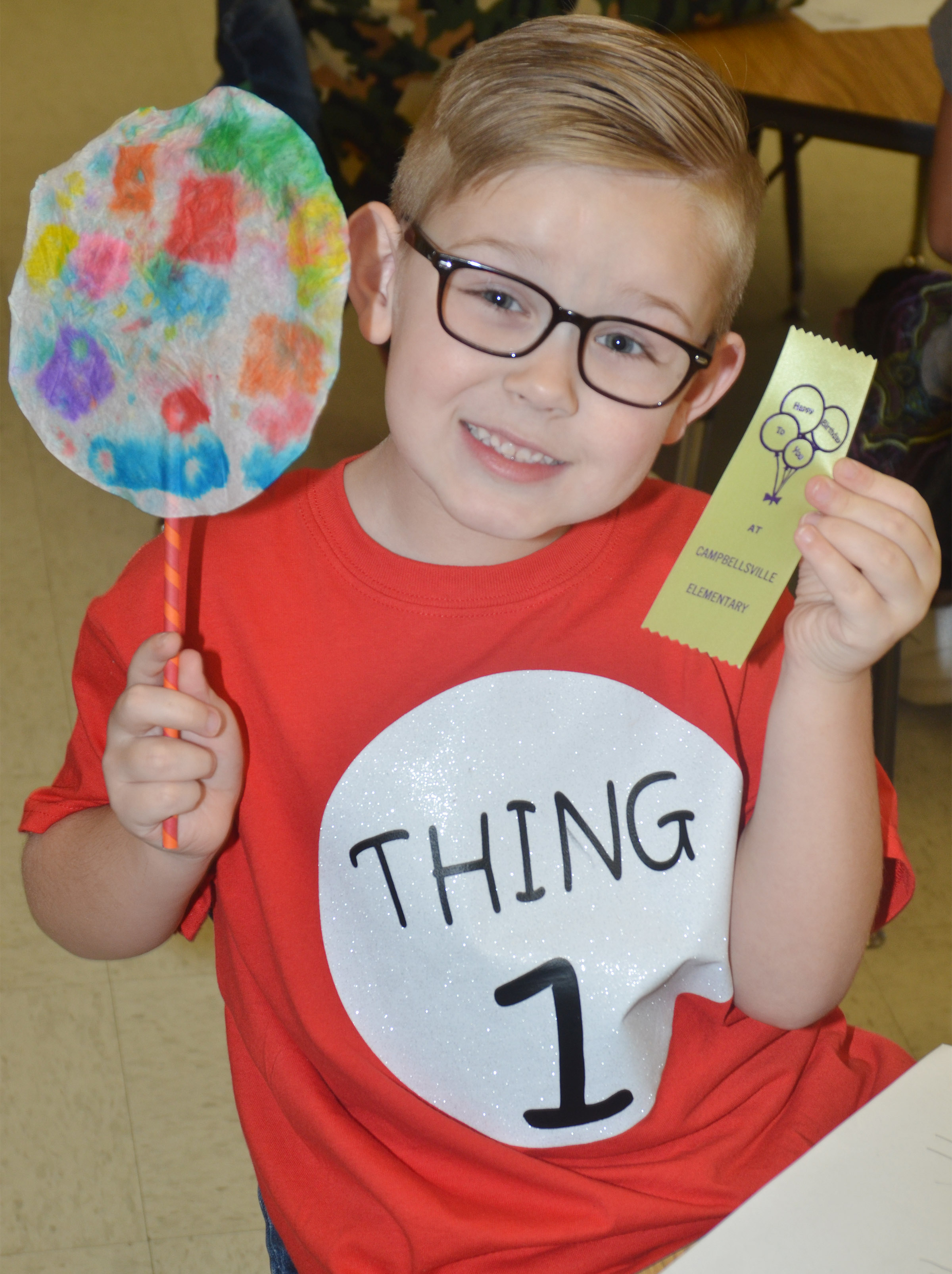 CES kindergartner John Hagan Newton holds his truffula tree.