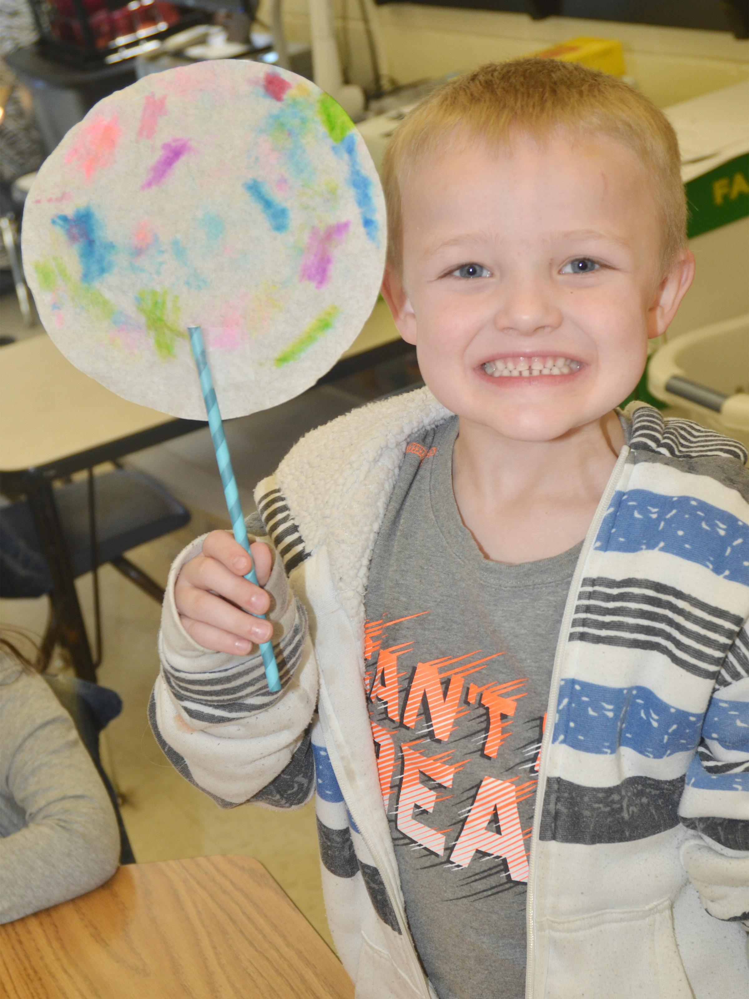 CES kindergartener Tristian Harris holds his truffula tree.